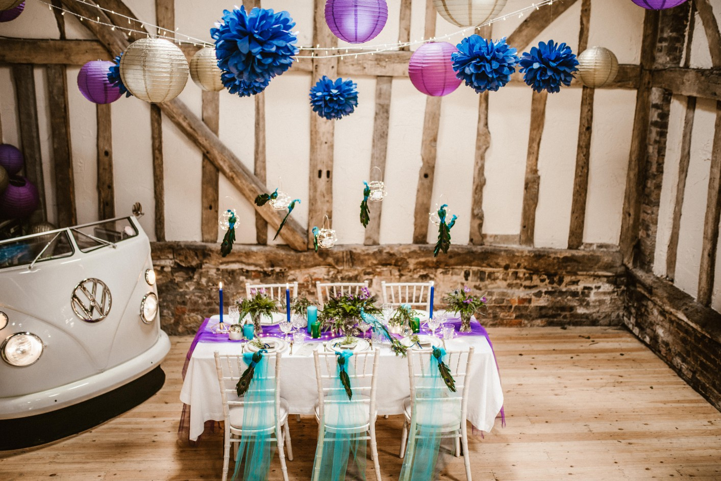 Peacock barns - alternative unconventional wedding photoshoot - rustic decadent - peacock ultraviolet inspired table set up