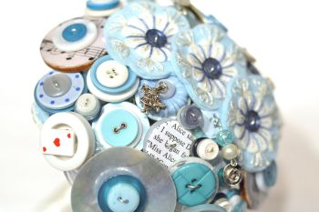 Alice in Wonderland wedding inspiration - custom bouquet with alice charms - alternative and unconventional wedding