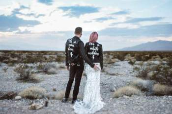 Sammy Lea's Retro Emporium - beach wedding - his and her custom leather jackets - alternative unconventional