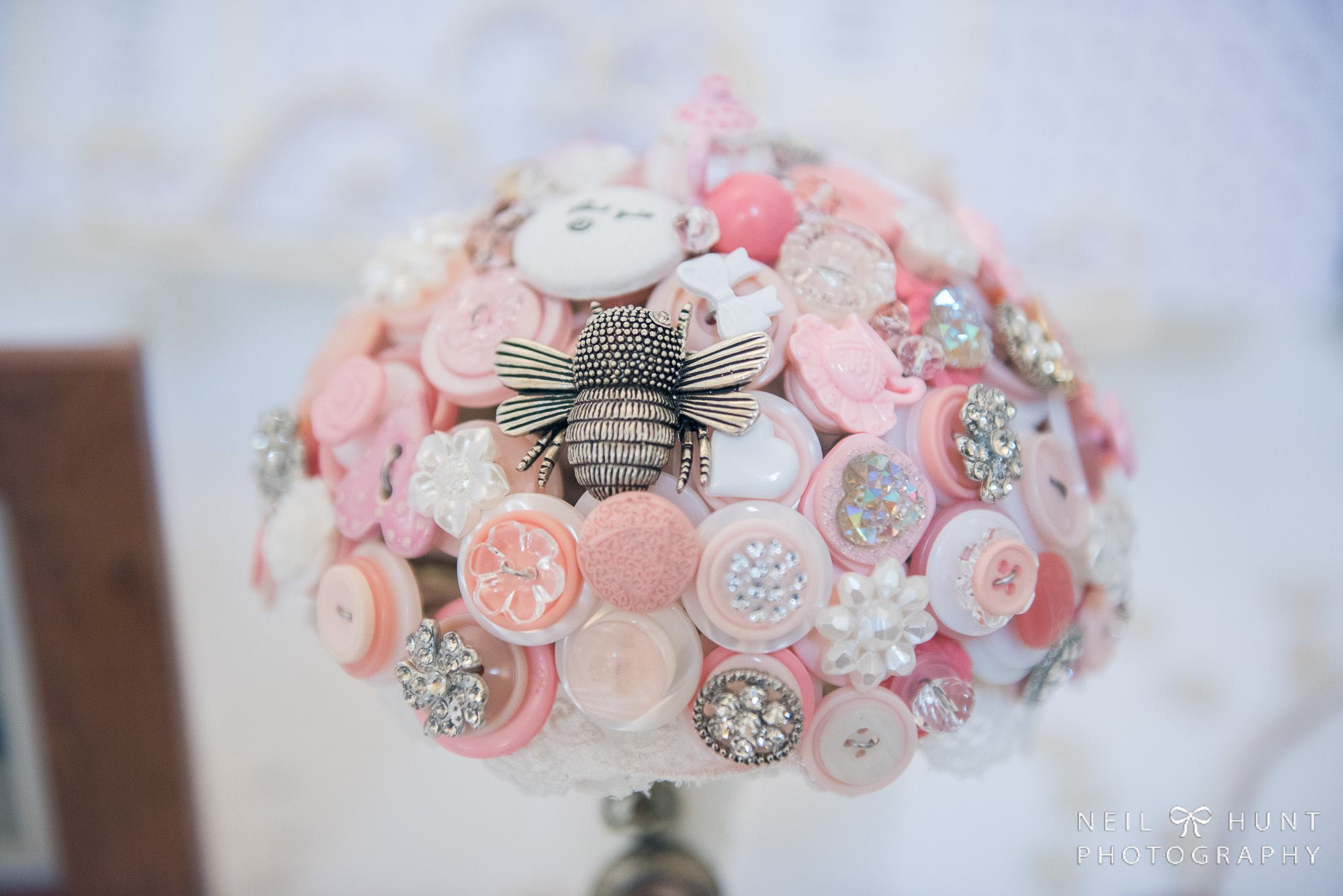 Alice in Wonderland wedding inspiration - button bouquet with bee - alternative and unconventional wedding