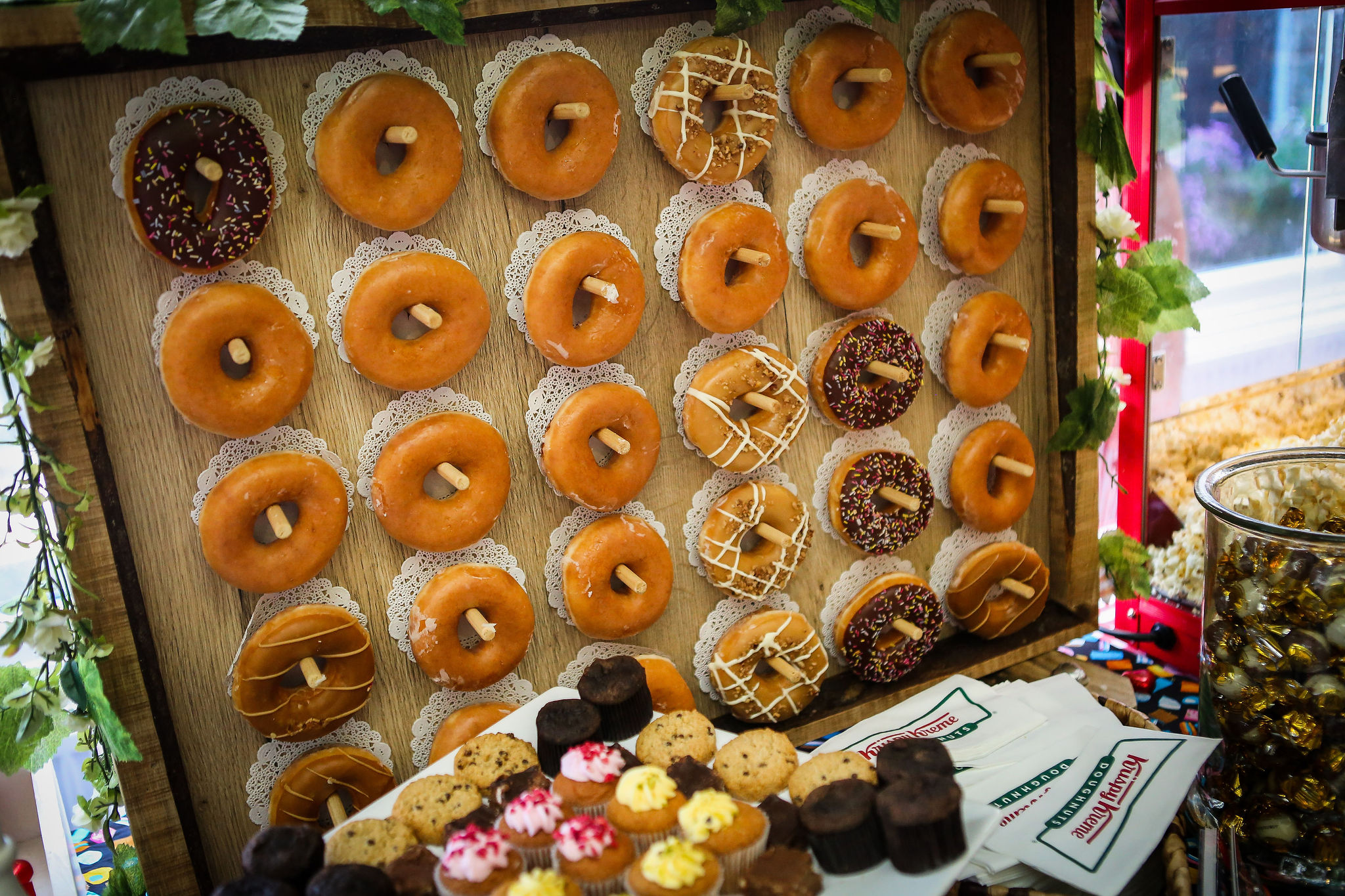 Harriet&Rhys Wedding - donut wall with krispy kremes and doilies!