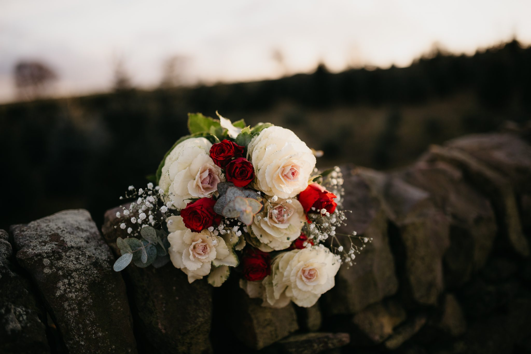 christmas elopement wedding- alternative wedding- christmas wedding- fly on the wall photography- red and white bouquet
