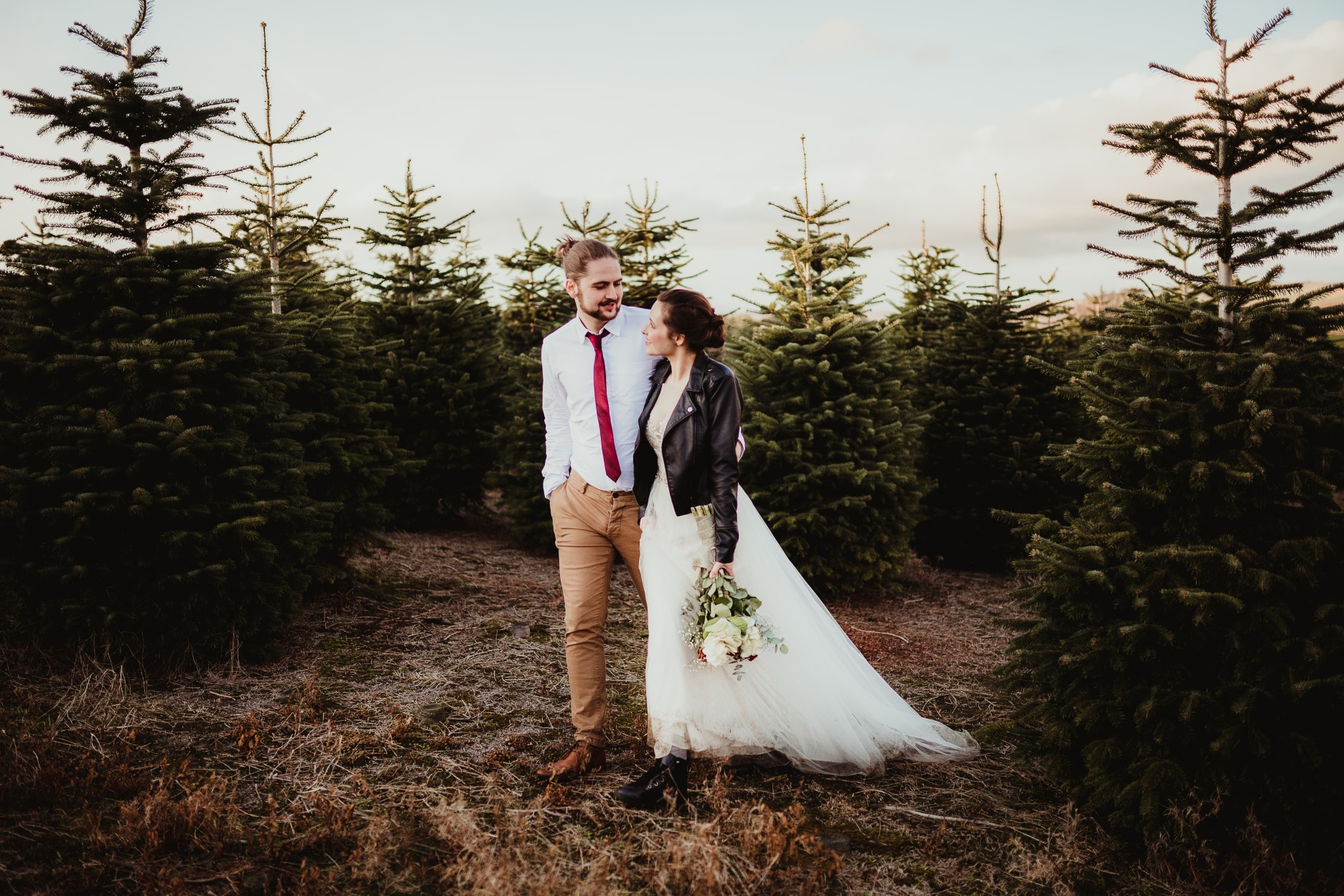 christmas elopement wedding- alternative wedding- christmas wedding- fly on the wall photography- couple at a christmas tree farm