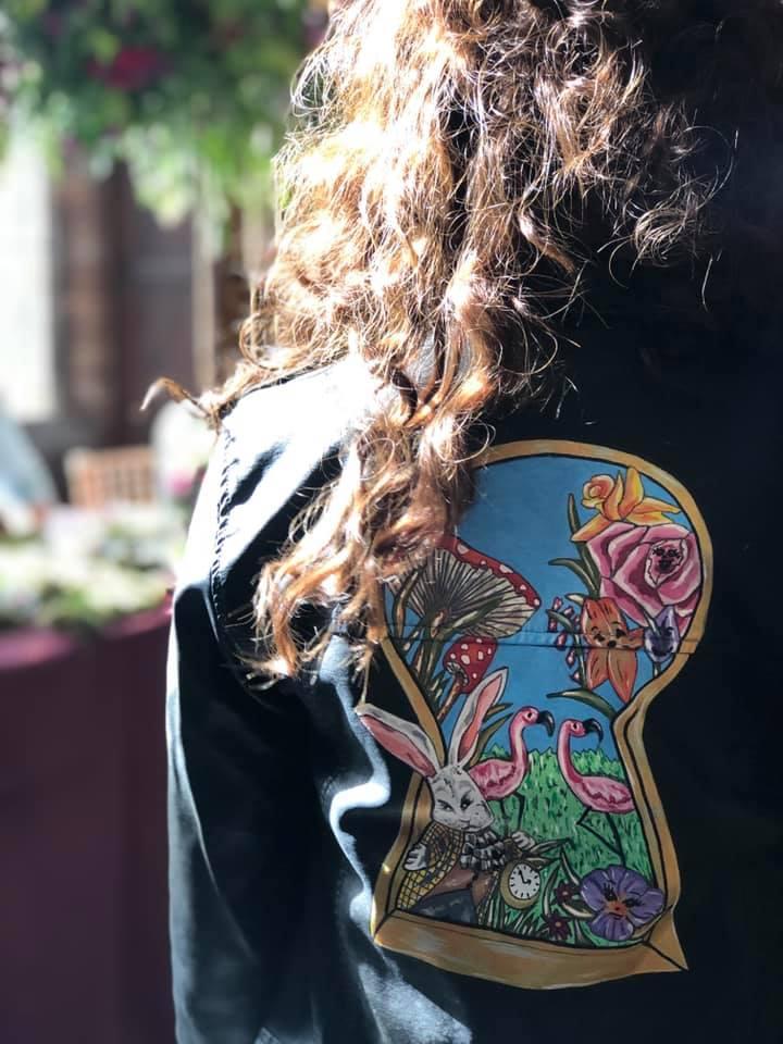 hand painted wedding leather jacket - alice in wonderland wedding - themed wedding inspiration - flamingos, rabbit, clock, mushrrooms and flowers through the keyhole - alternative wedding inspiration by sammy lea's retro emporium