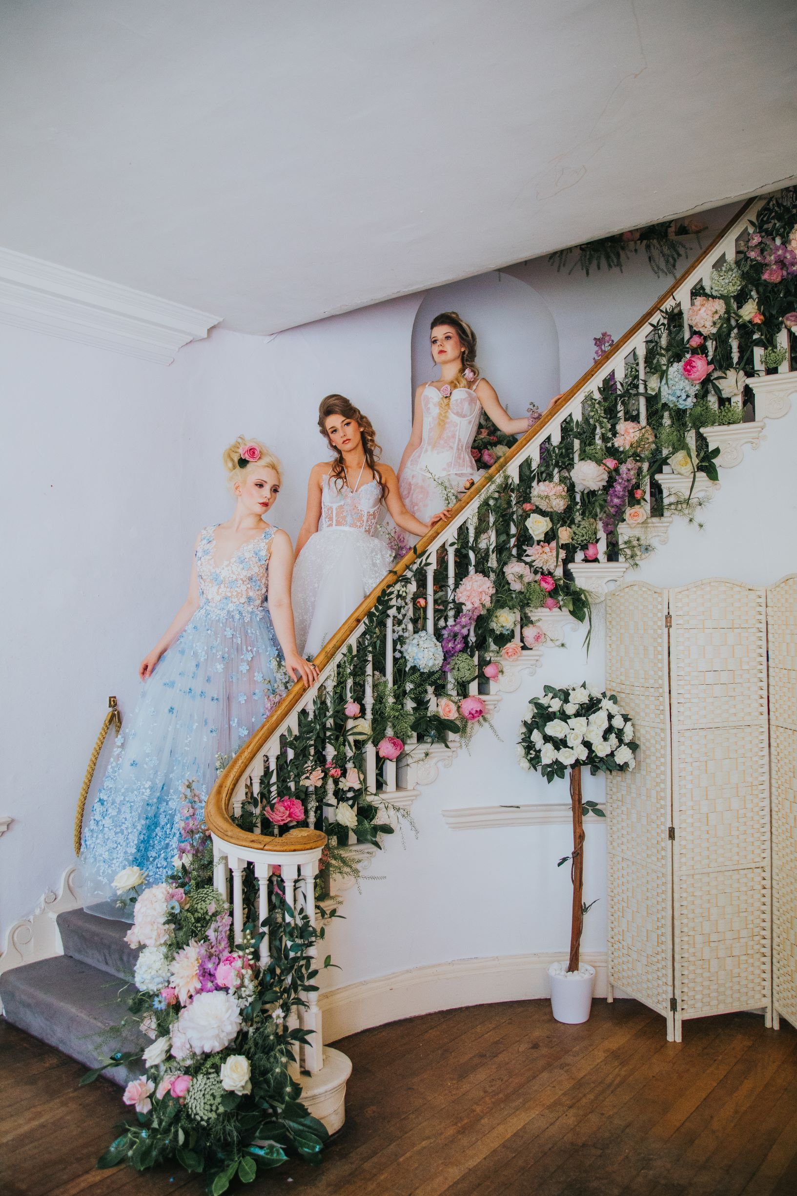 Whimsical wedding- Laura Beresford Photography- unconventional wedding- alternative wedding- brides on staircase- alternative wedding flowers- blue wedding dress