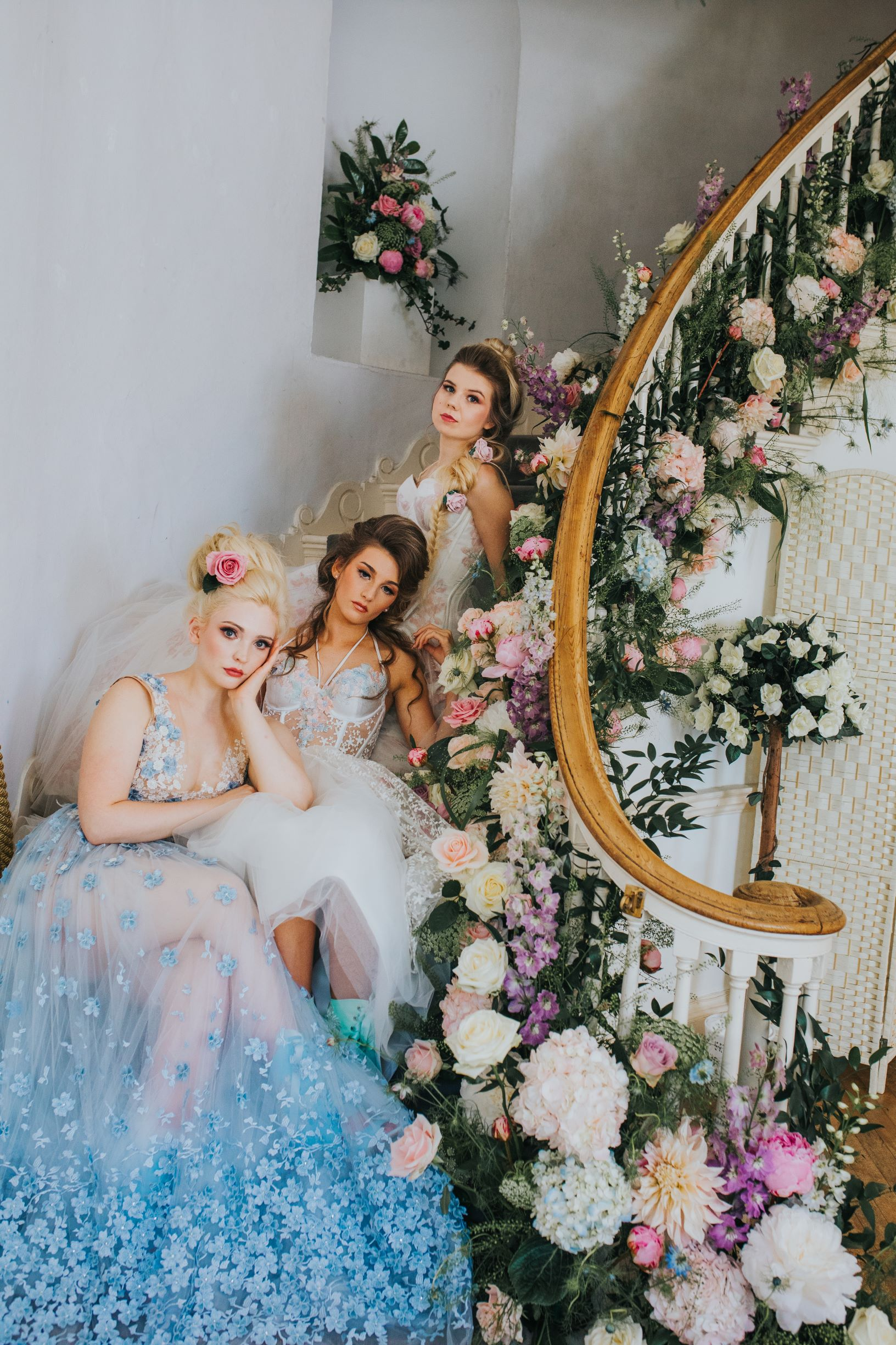 Whimsical wedding- Laura Beresford Photography- unconventional wedding- alternative wedding- brides on staircase- unique wedding flowers- alternative bridal wear