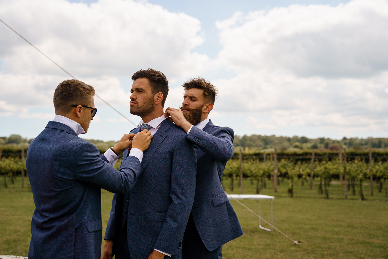 Getting Married Abroad- Grooms Perspective- Wedding Planning for Men- Unconventional Wedding- Katherine And Her Camera- groomsmen putting on ties