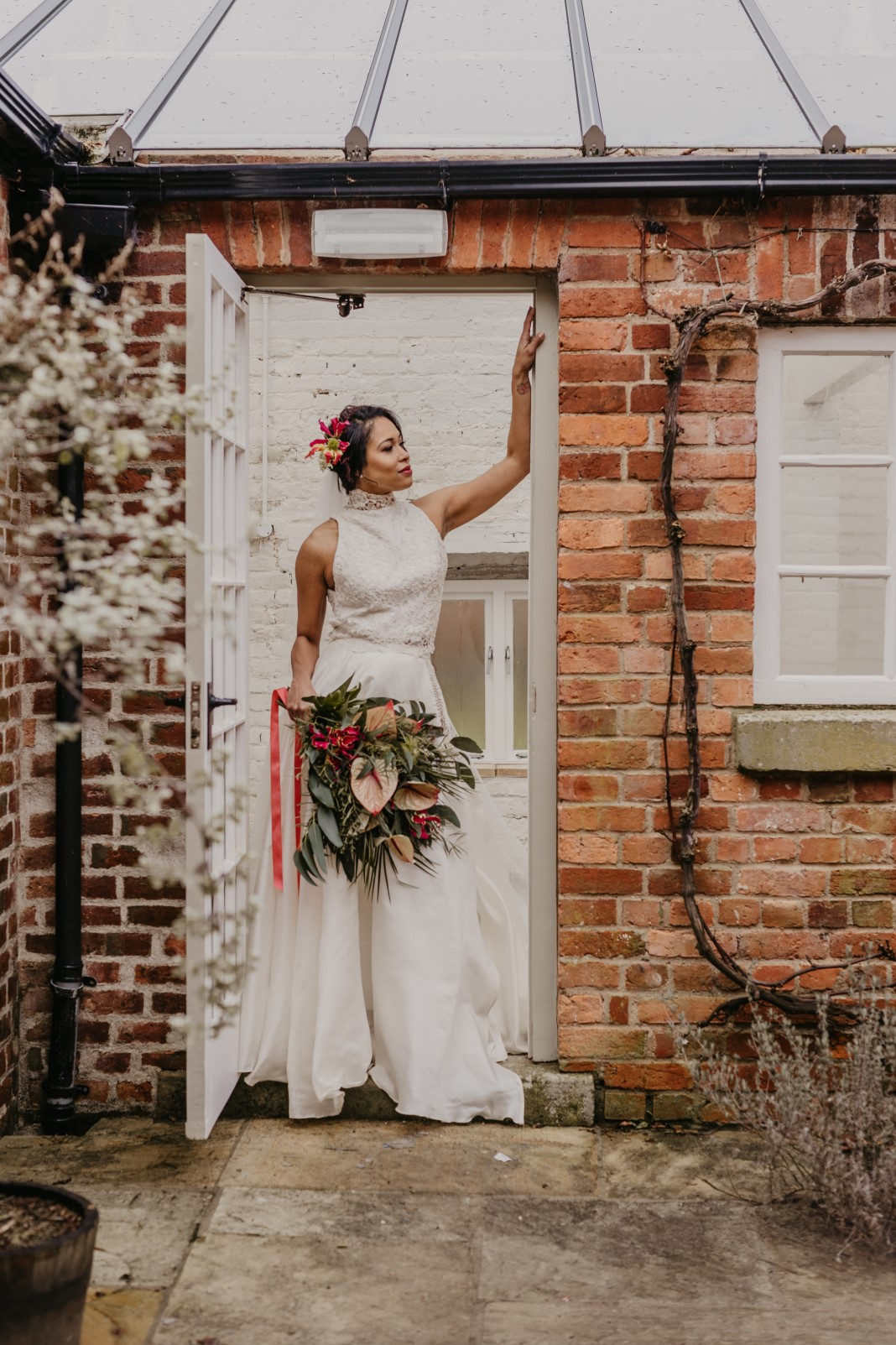 tropical opulence wedding- tropulence- twigs branch photography- unconventional wedding- bride in doorway