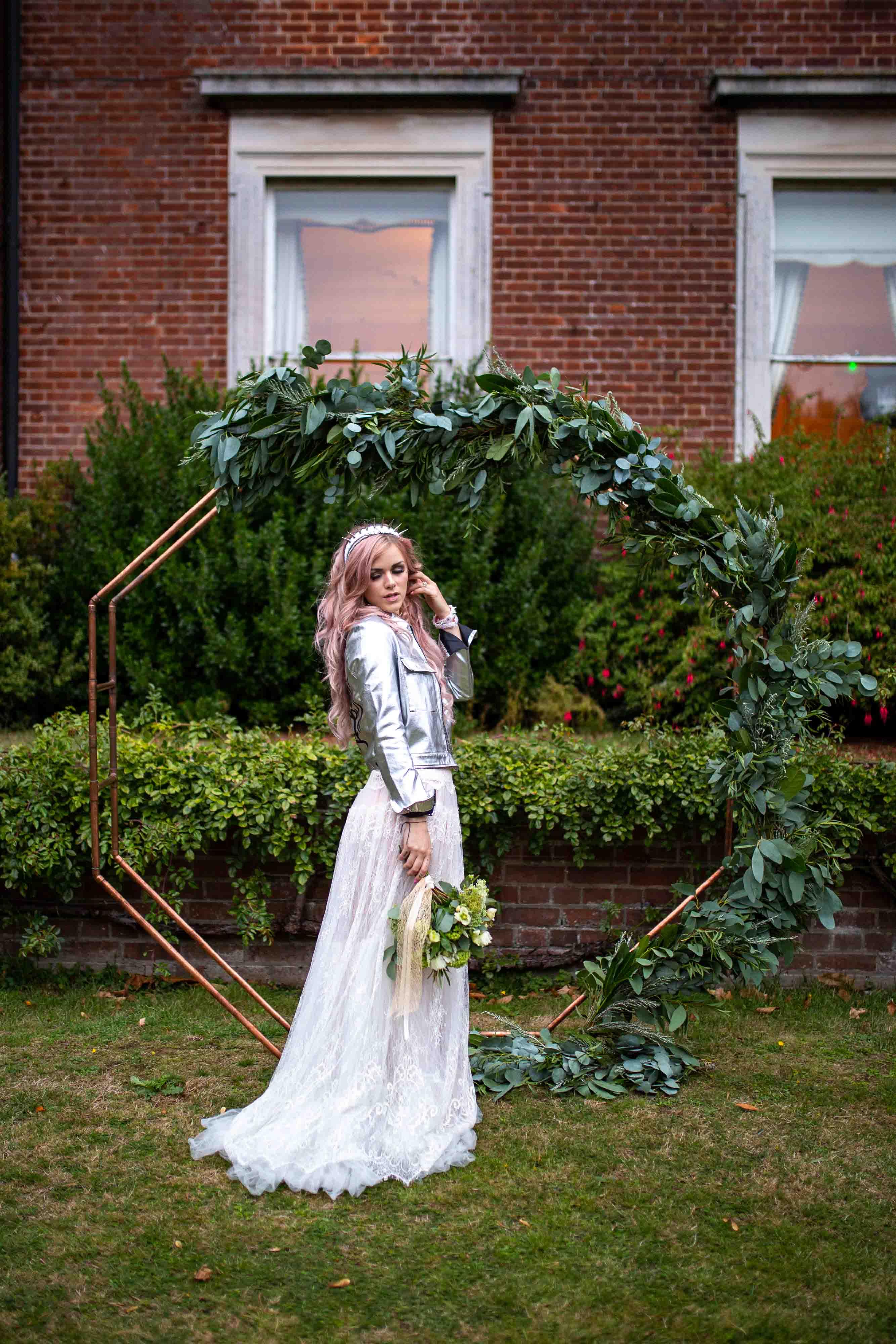 iconic wedding looks- music themed wedding- unconventional wedding- alternative wedding- grunge wedding dress- silver leather jacket- boho wedding backdrop