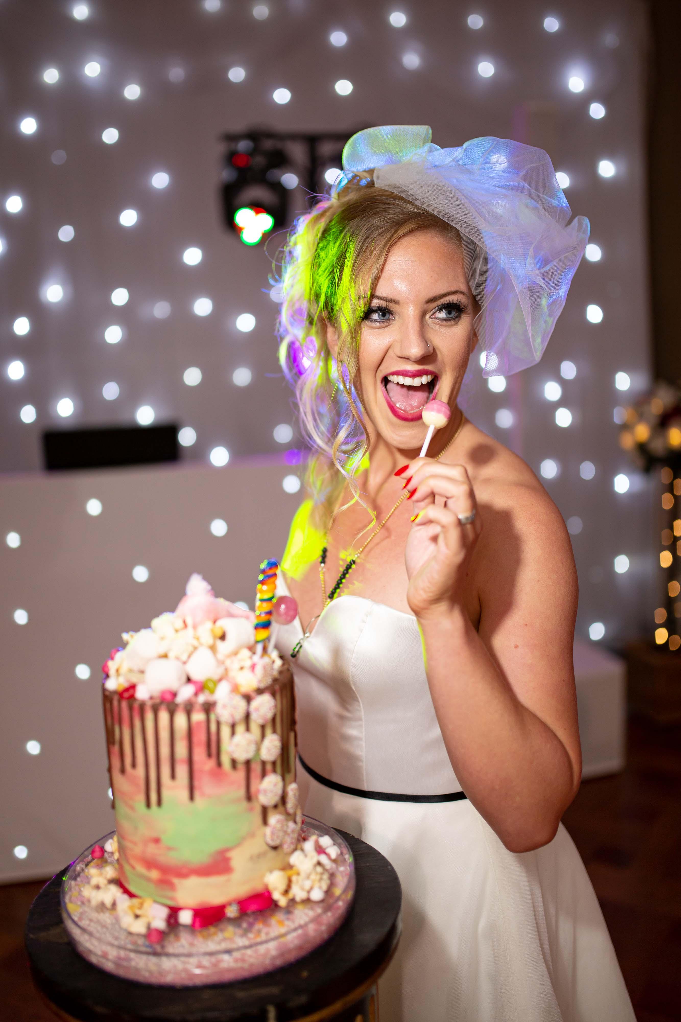 iconic wedding looks- music themed wedding- unconventional wedding- alternative wedding- madonna wedding dress- madonna wedding- sweetie wedding cake- fun wedding