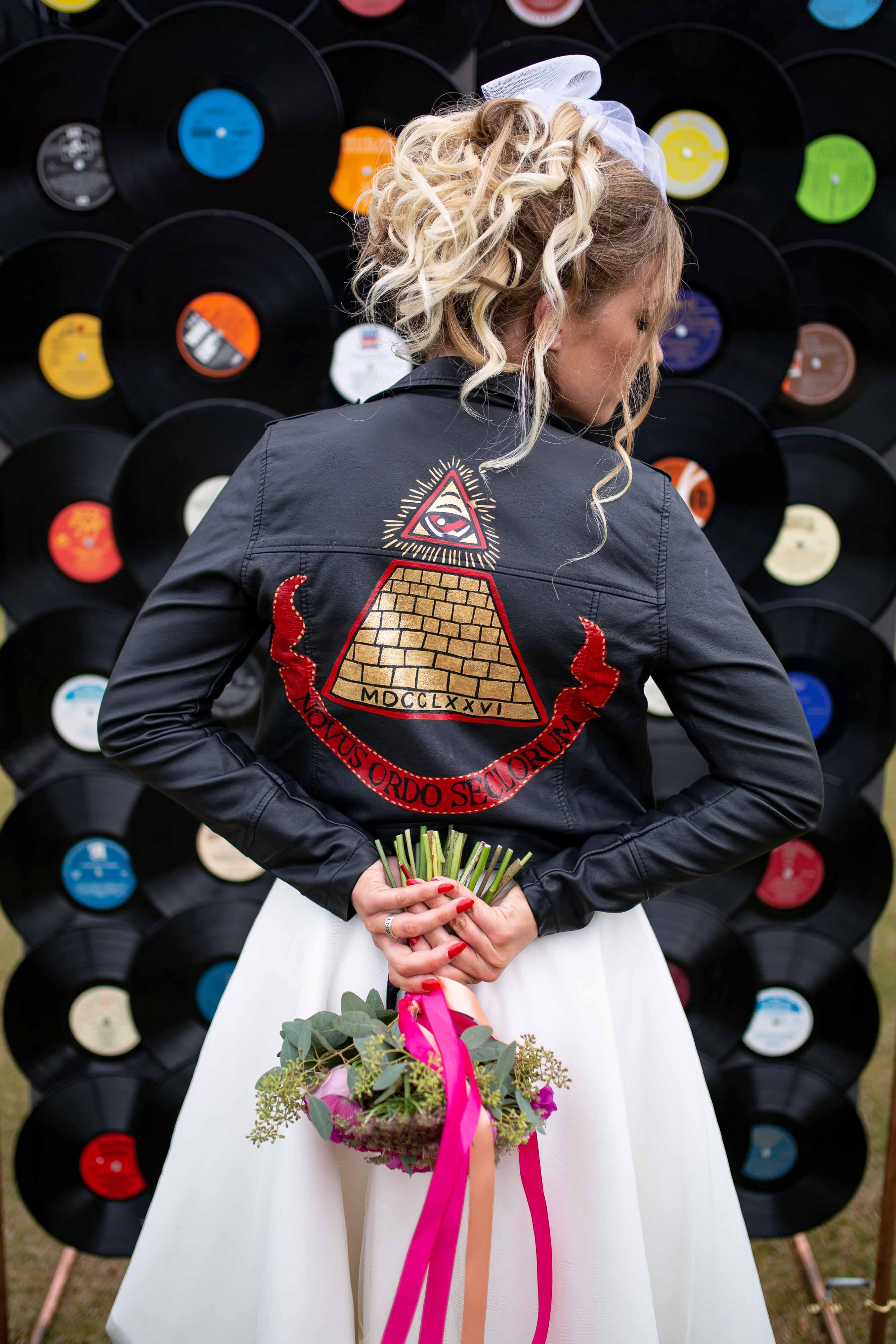 iconic wedding looks- music themed wedding- unconventional wedding- alternative wedding- madonna wedding dress- wedding leather jacket- hand painted leather jacket