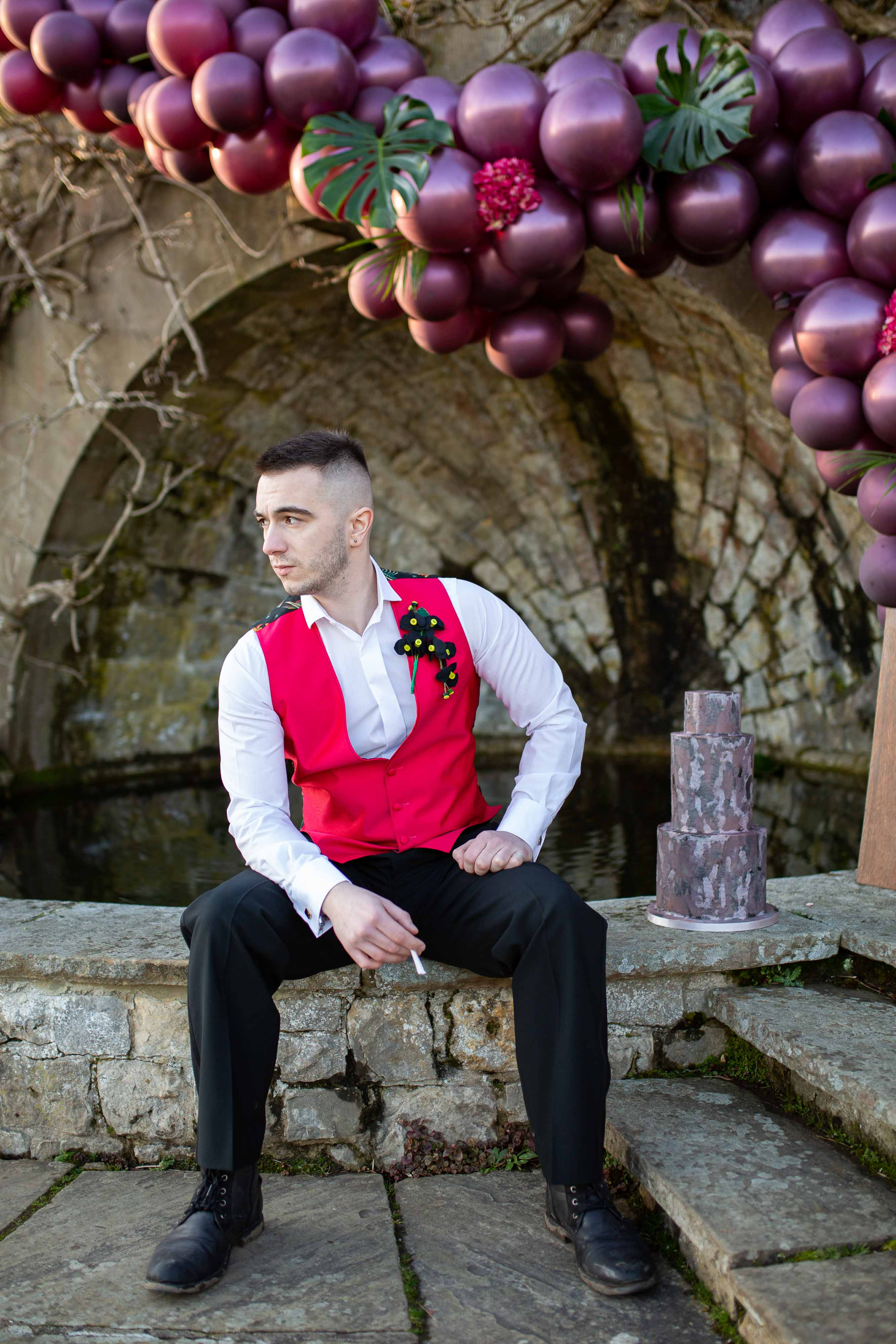 wedding menswear- alternative groomswear- music themed wedding- bake to the future- florence berry photography- mens red waistcoat- punk wedding