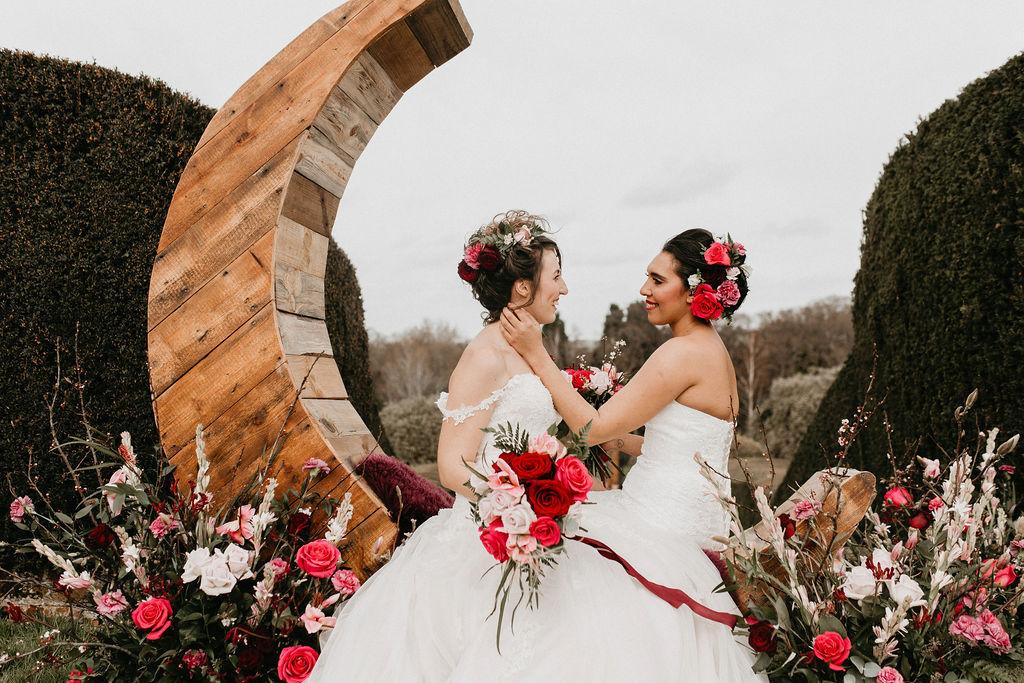 romantic woodland wedding - whimsical wedding- shakespeare wedding- unconventional wedding- romantic wedding photo- brides surrounded by roses