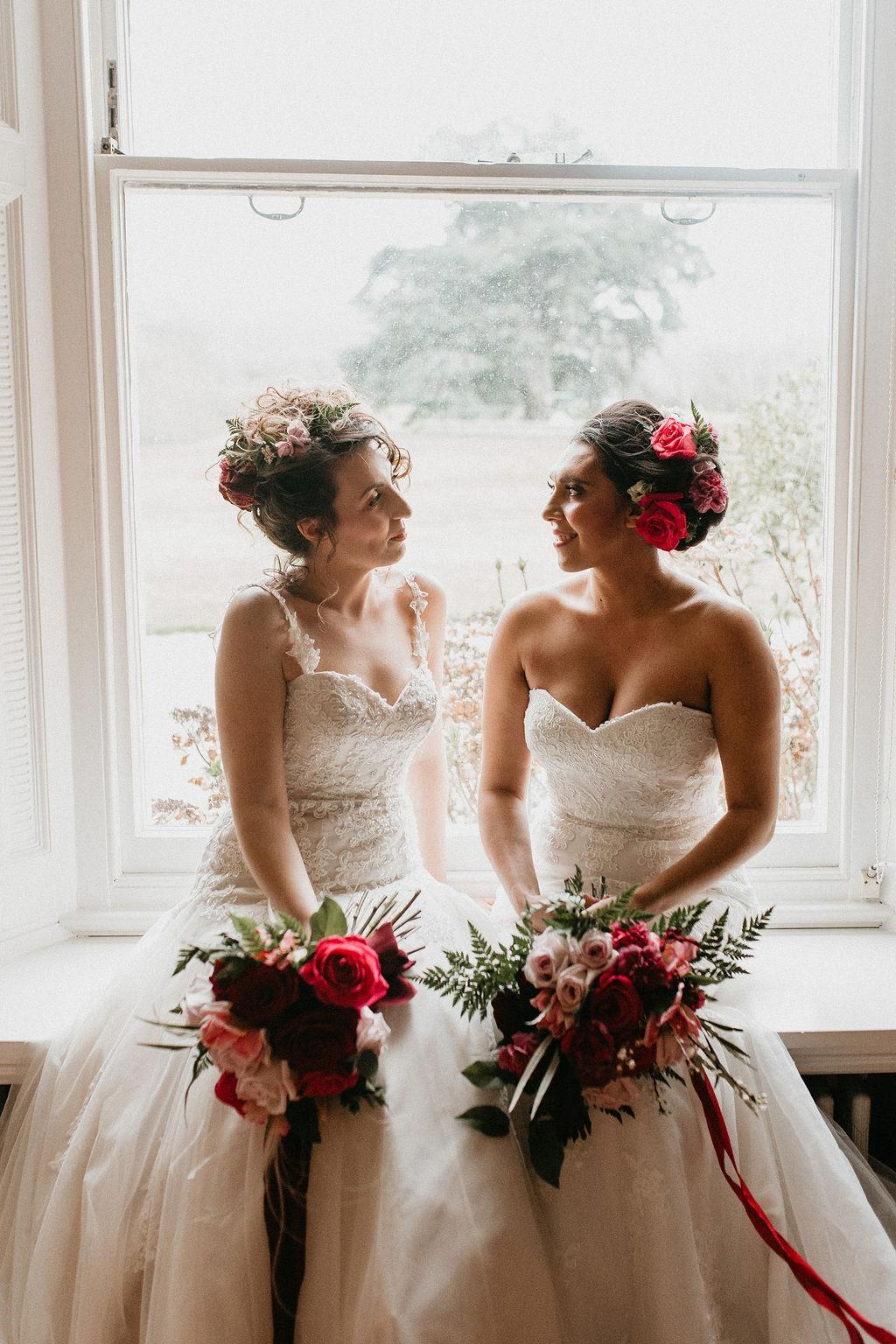 romantic woodland wedding - whimsical wedding- shakespeare wedding- unconventional wedding- same sex wedding photo- brides in windowsill