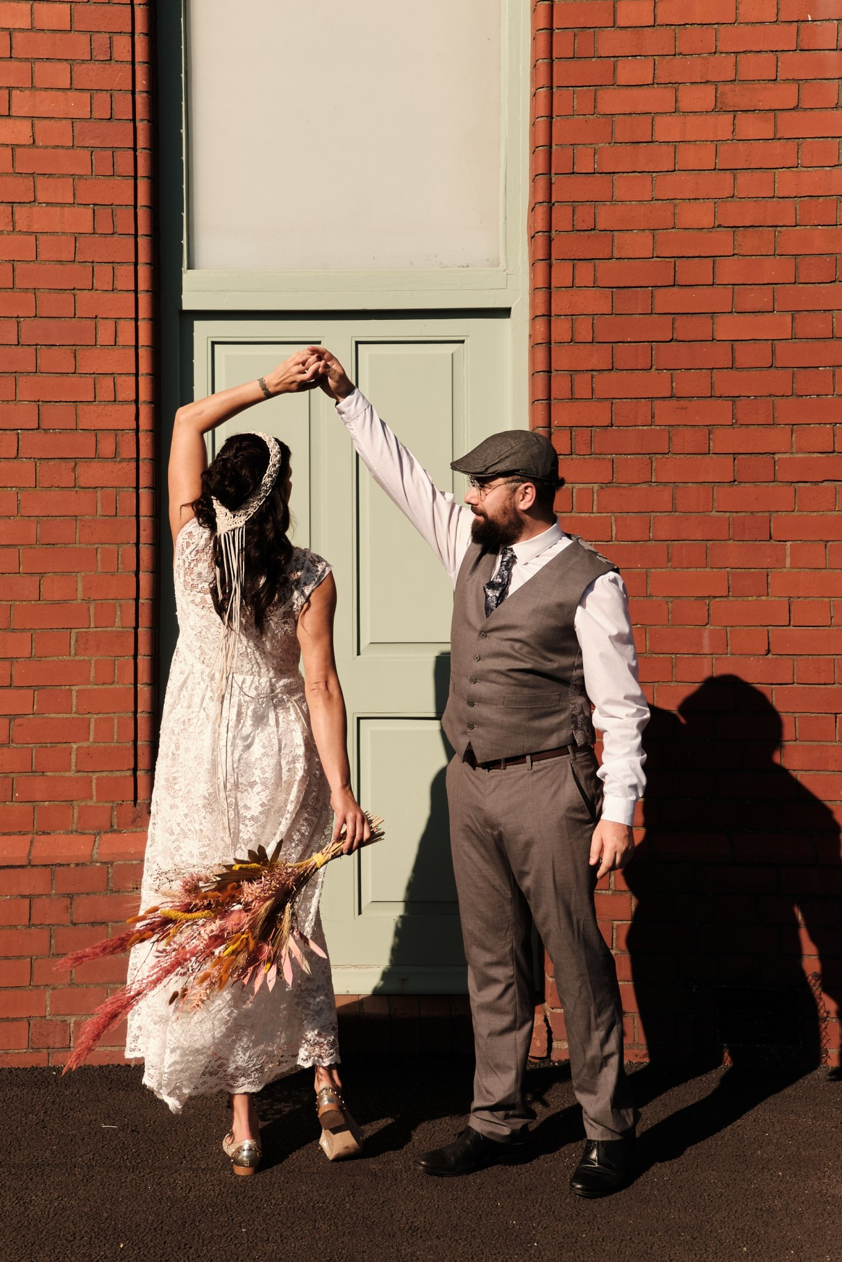 city elopement- cardiff bay wedding- wales elopement- urban elopement - cardiff wedding - colourful summer wedding- bride and groom dancing