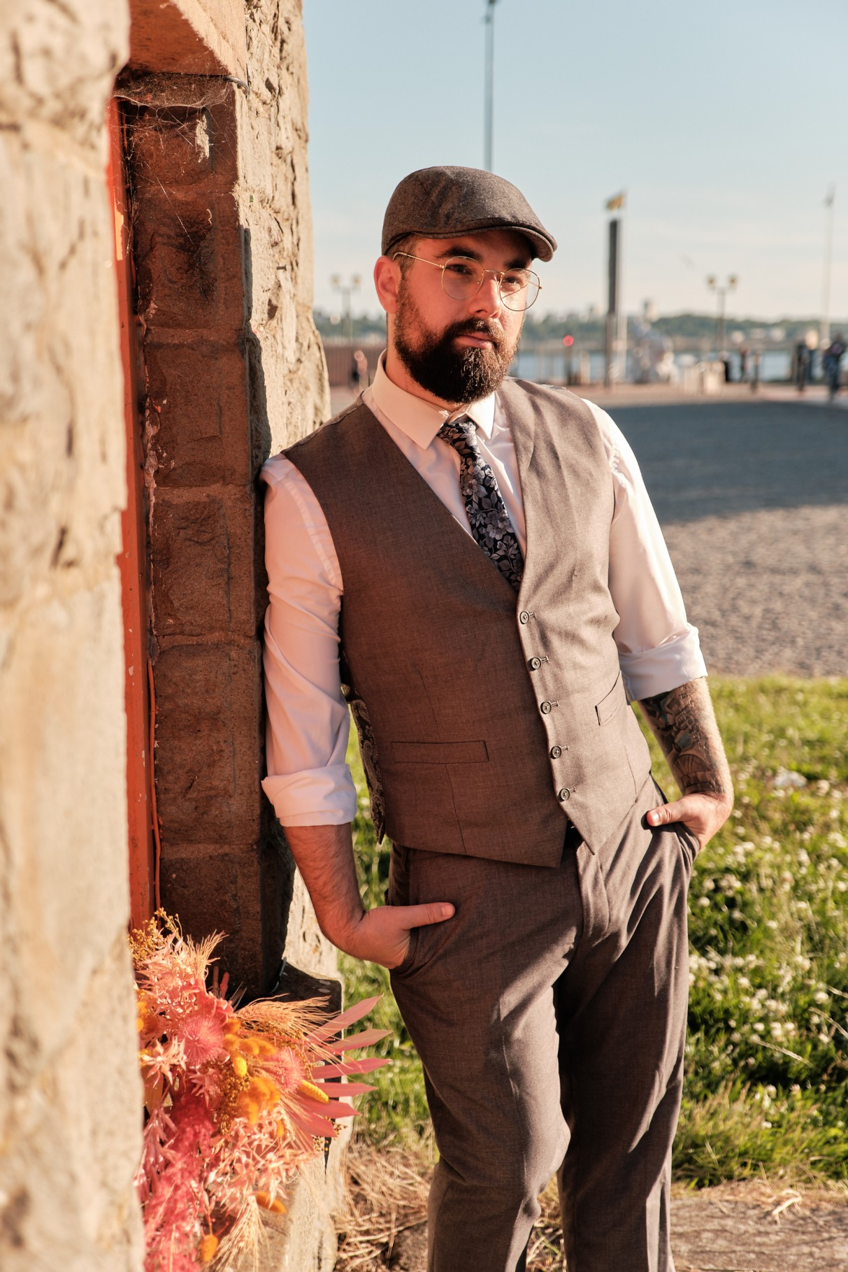 city elopement- cardiff bay wedding- wales elopement- urban elopement - cardiff wedding - colourful summer wedding- groom in waistcoat and flat cap