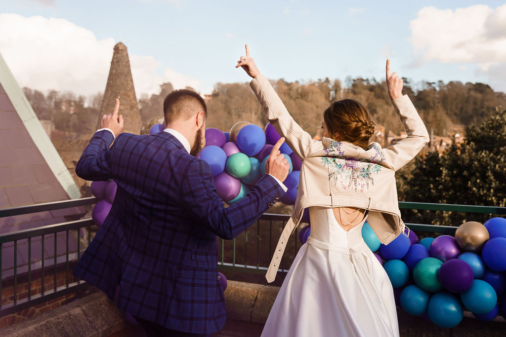 peacock themed wedding - peacock wedding - unique wedding colour scheme - quirky wedding - fun wedding - bride and groom dancing