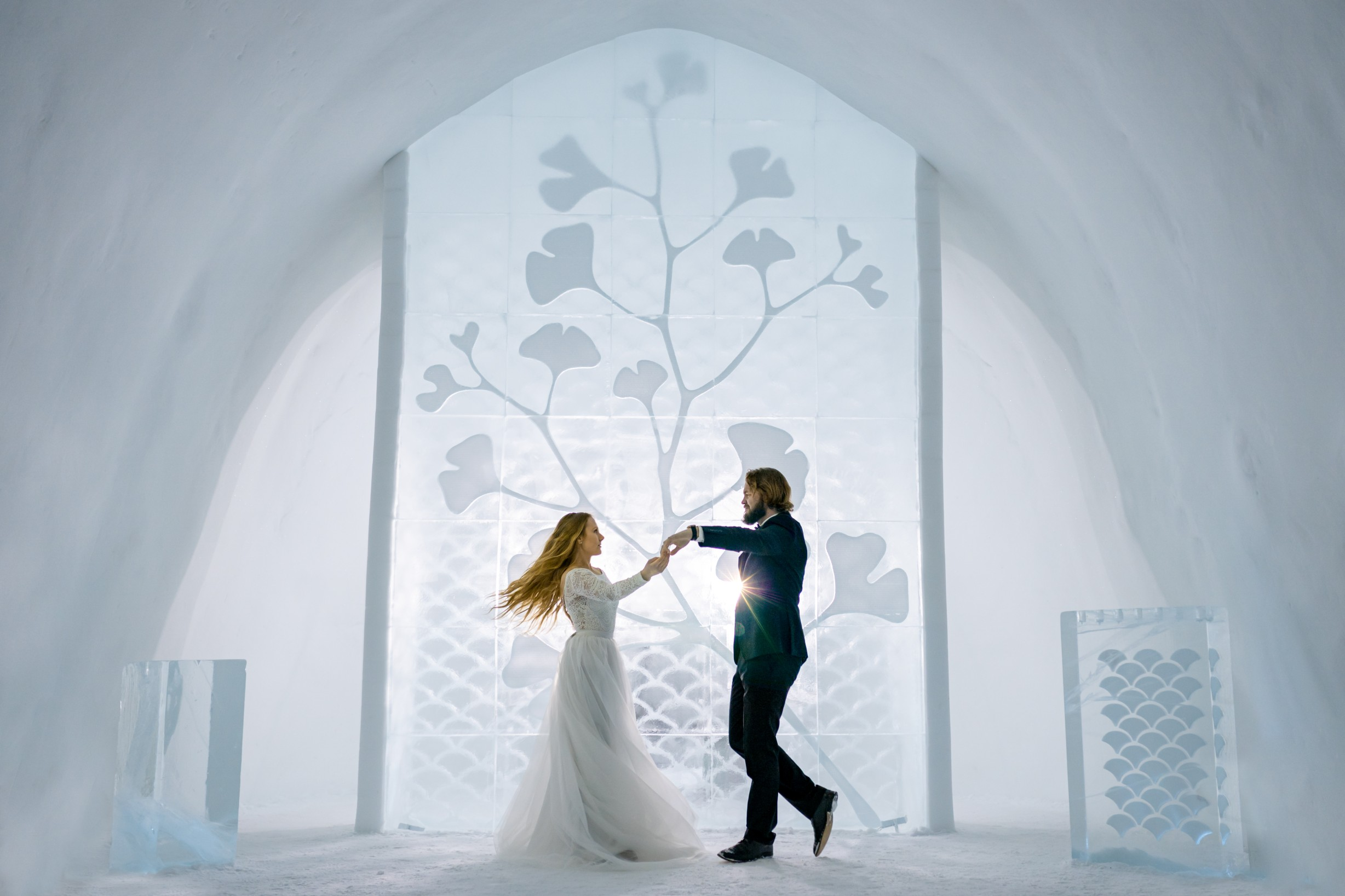 winter wedding at icehotel sweden - cinematic wedding photography - ice wedding - elopement in sweden - creative wedding photographer - unconventional wedding - alternative wedding - unique wedding - artistic wedding - bride and groom dancing