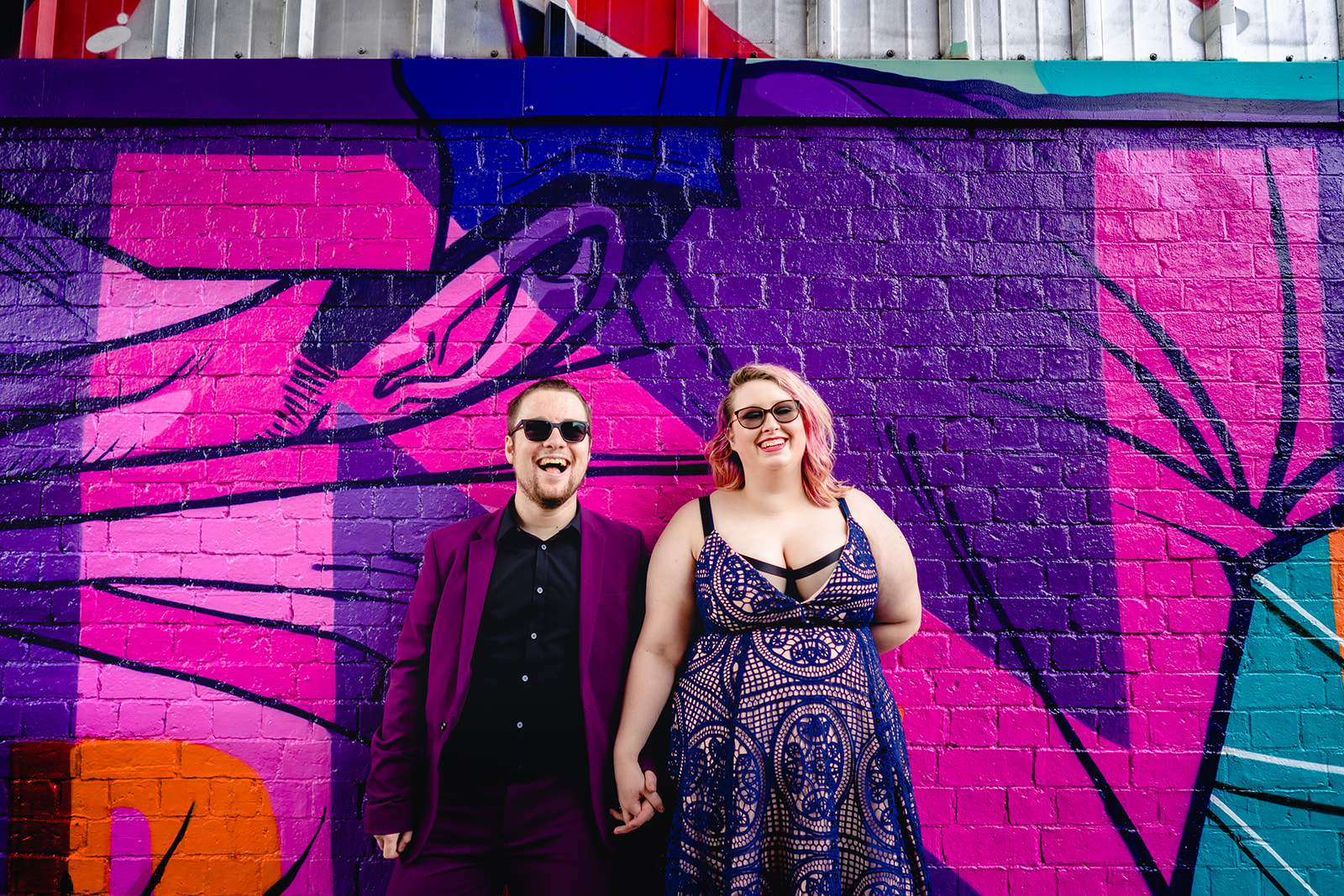 engagement shoots - birmingham engagement shoot - colourful wedding photoshoot - quirky wedding photos - fun wedding photography - alternative wedding - couple holding hands in front of colourful wall