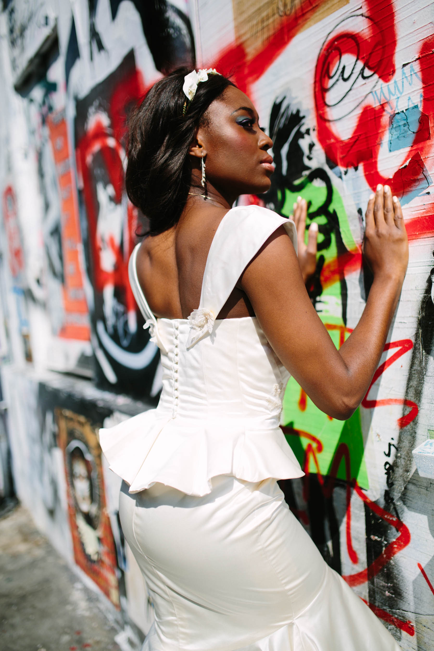 city bride - burlesque wedding - alternative wedding dress - unique wedding dress - figure flattering wedding dress - peplum wedding dress - bride against graffiti wall