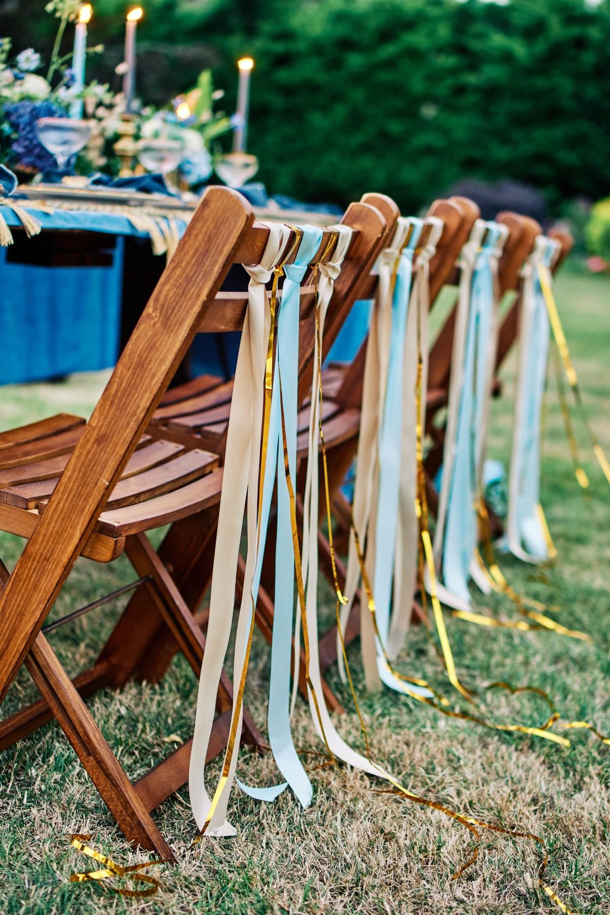 nhs wedding - paramedic wedding - blue and gold wedding - outdoor wedding - micro wedding - surprise wedding - wedding festival chair decoration