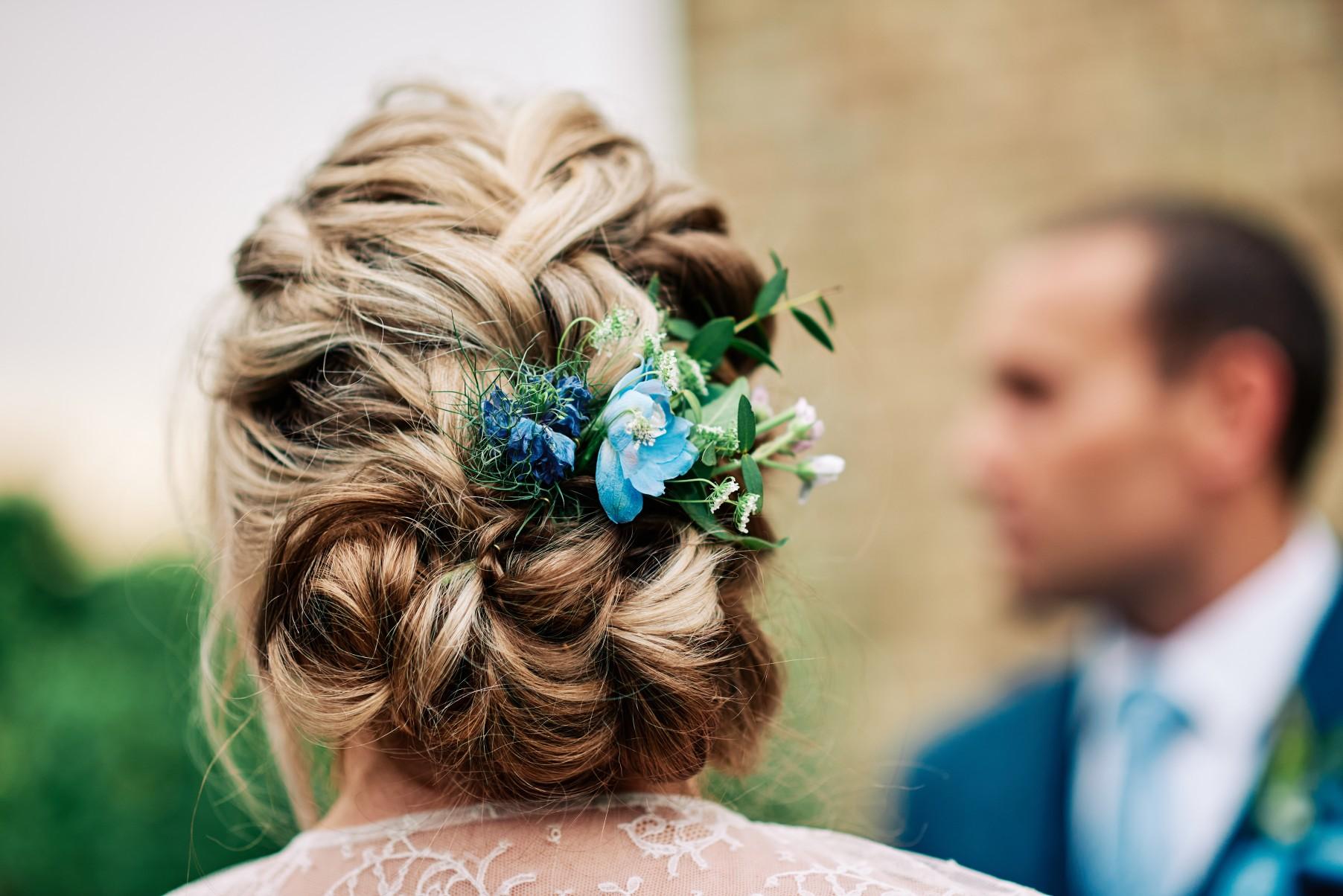 nhs wedding - paramedic wedding - blue and gold wedding - outdoor wedding - micro wedding - surprise wedding - celebrant wedding ceremony- blue flower in bride's hair
