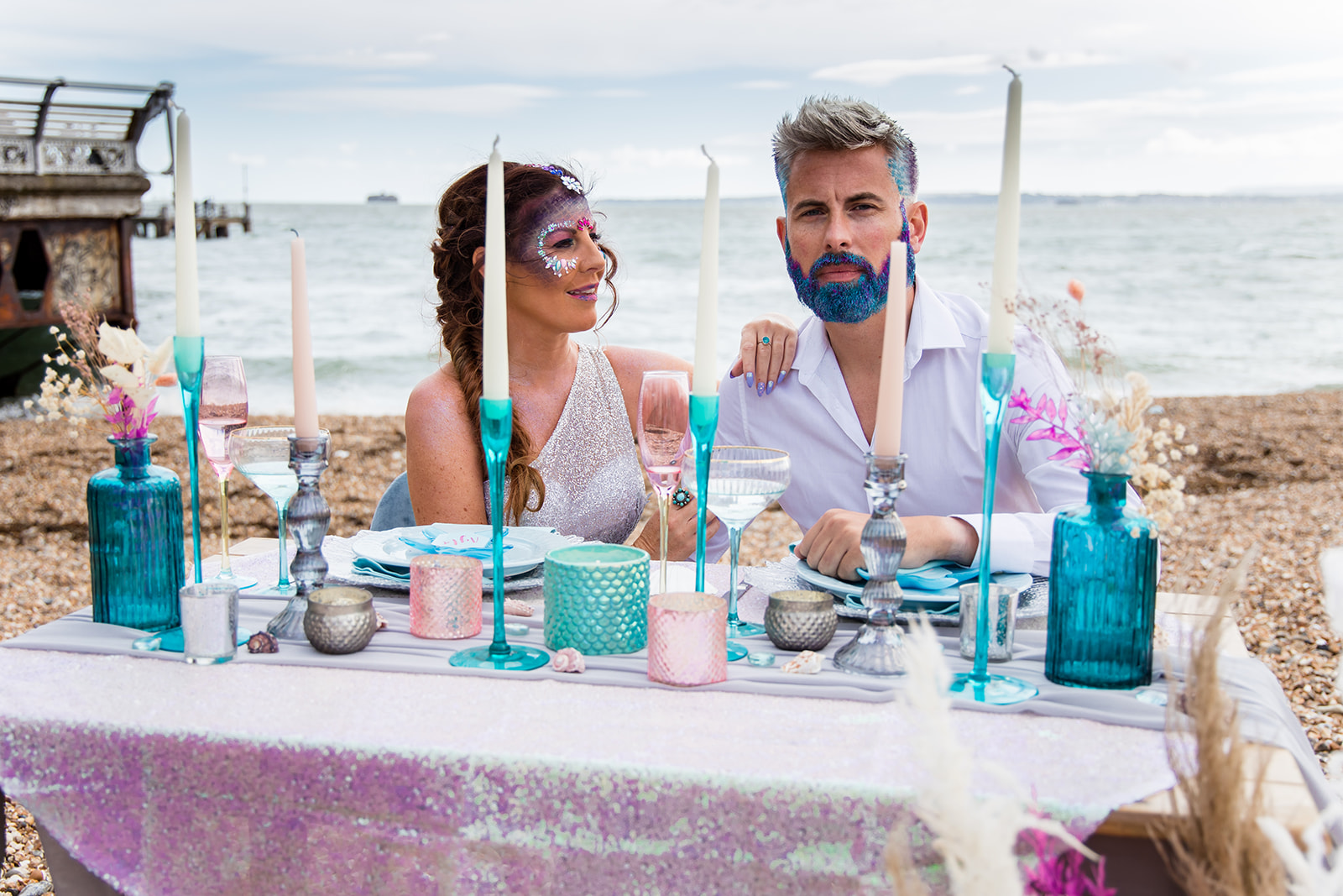 mermaid wedding - beach wedding - quirky wedding - unique wedding - alternative seaside wedding - alternative wedding - wedding beard glitter - wedding face glitter - bride qnd groom sat at table