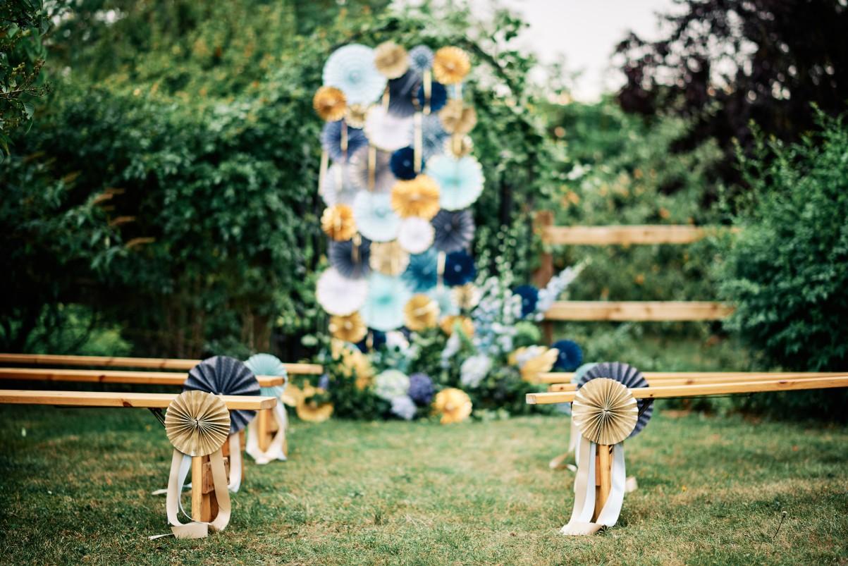 nhs wedding - paramedic wedding - blue and gold wedding - outdoor wedding - micro wedding - surprise wedding - blue and gold wedding backdrop