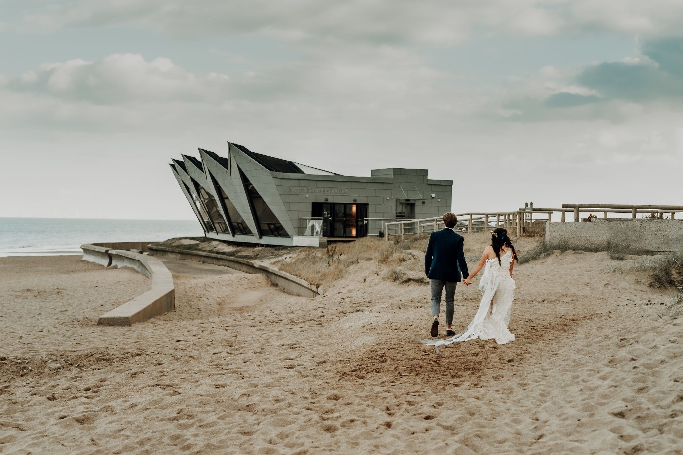 beach elopement - beach wedding - eco friendly wedding -tempest themed wedding - bride and groom on beach