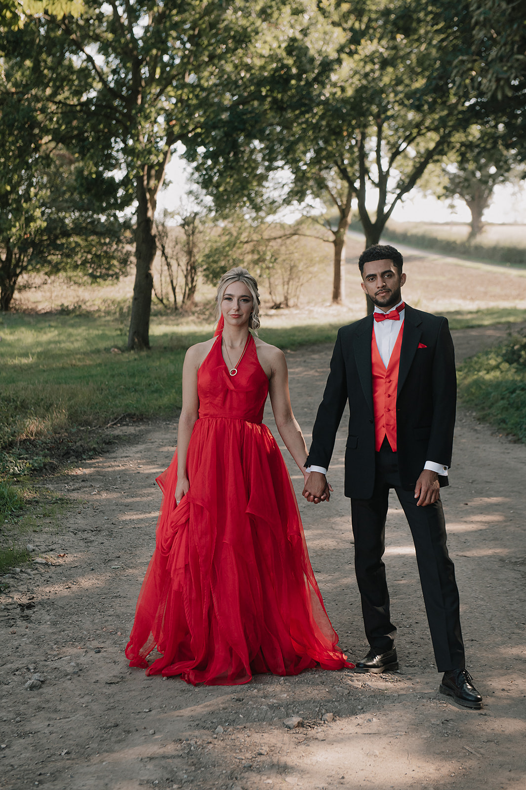 red wedding - forest elopement photoshoot - red wedding dress - red groomswear - coloured wedding dress