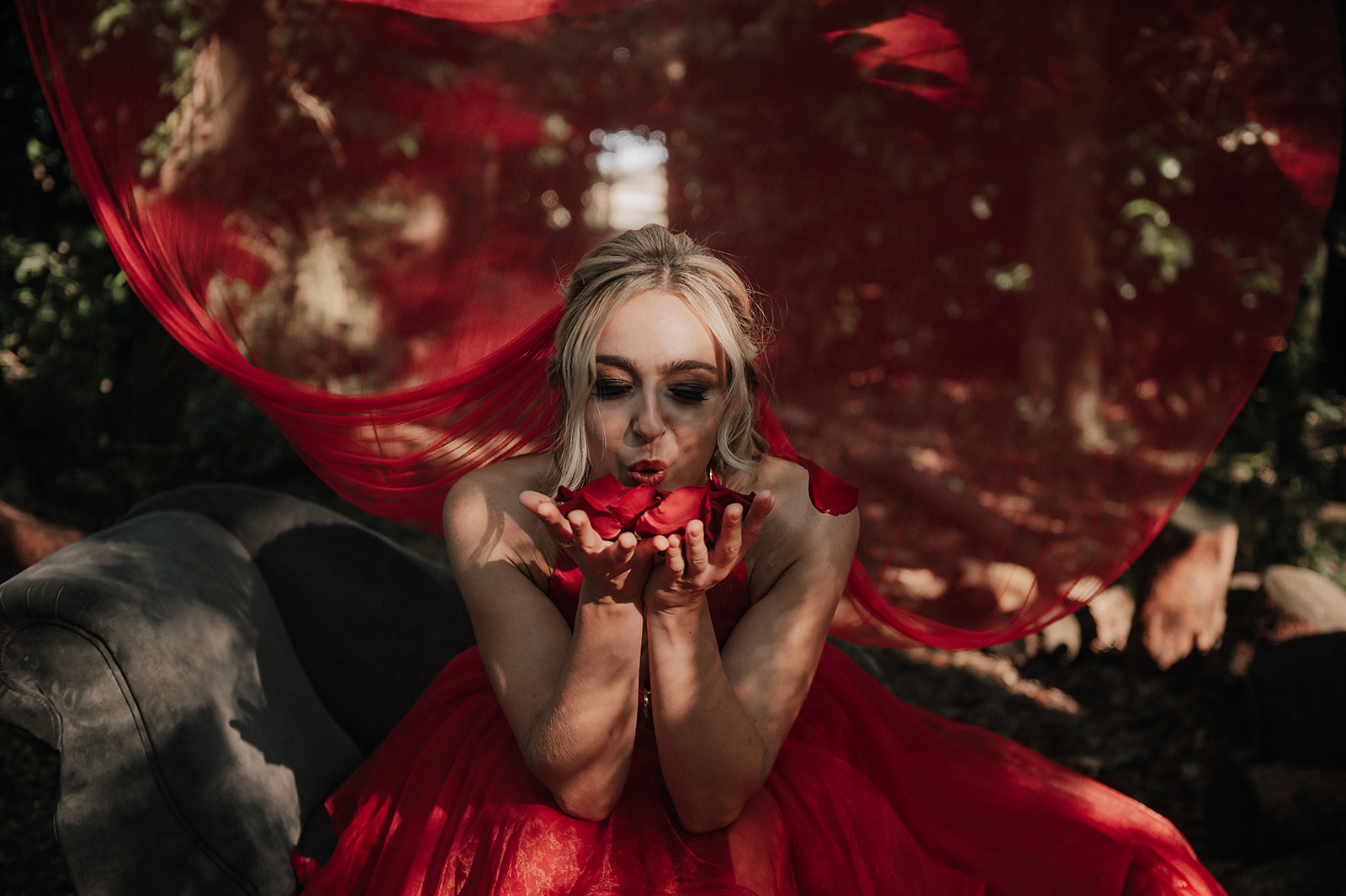 red wedding dress & red veil - bride blowing rose petals - unique wedding dress - red veil