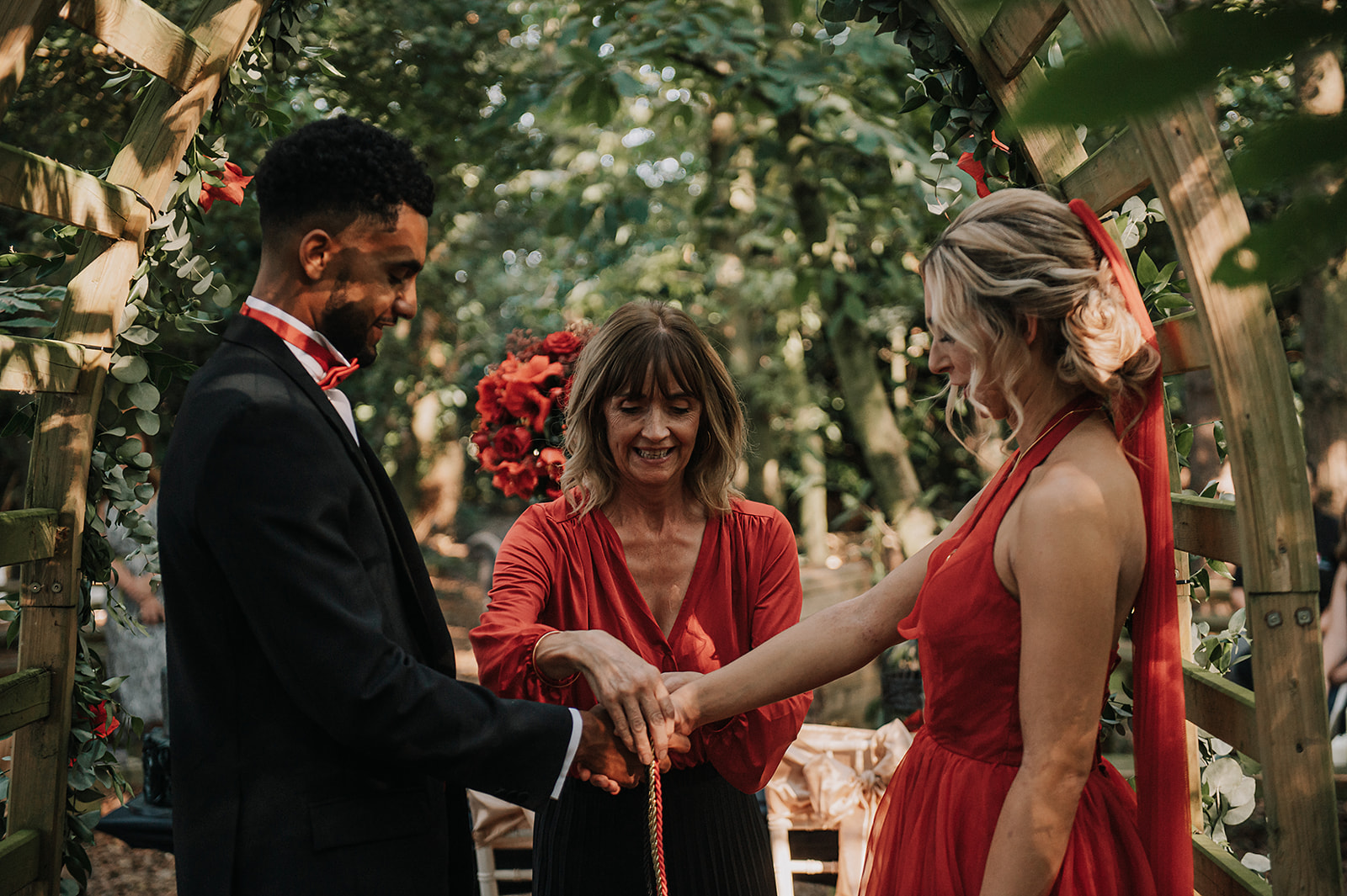 red wedding - forest elopement - forest handfasting ceremony - small wedding ceremony- red wedding dress