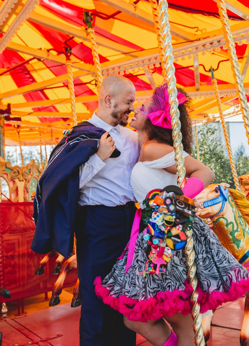 fairground wedding - fun wedding photos - carousel wedding photos - funfair wedding - 80s wedding
