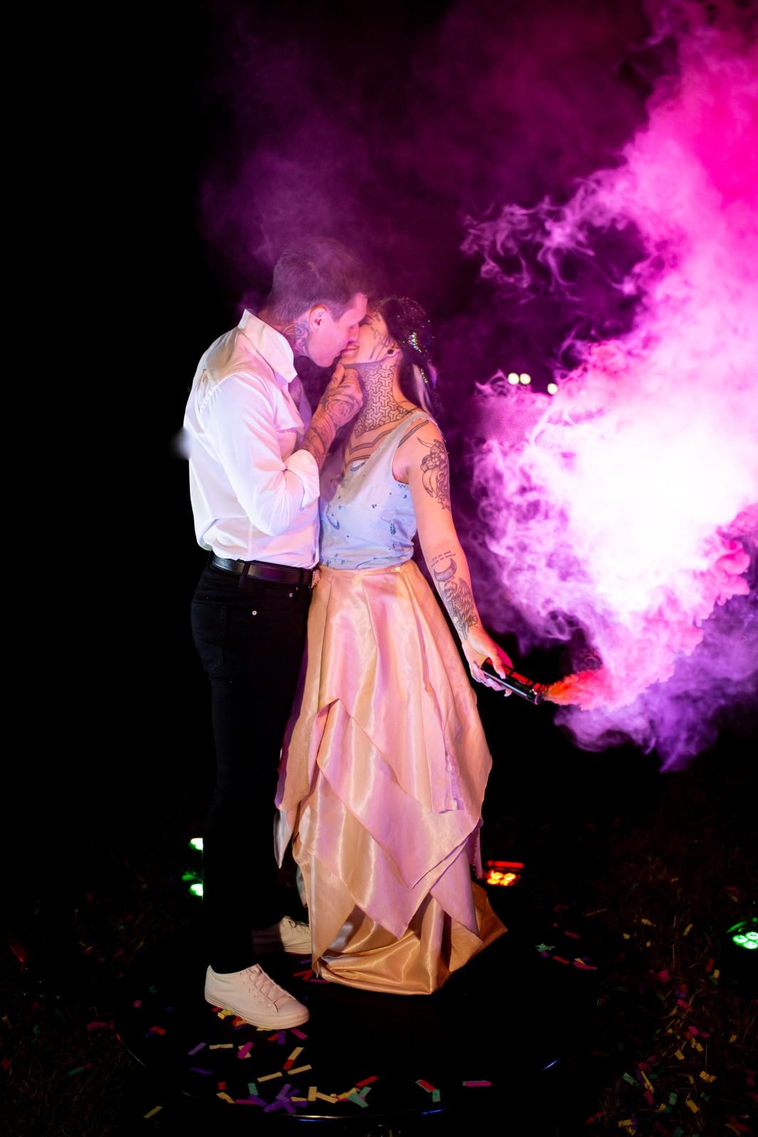 rainbow festival wedding - smoke bomb wedding photo - bride and groom with pink smoke bomb