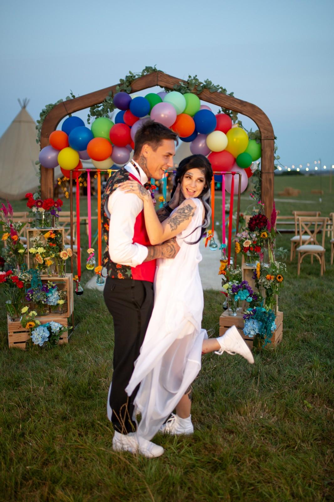 rainbow festival wedding - colourful wedding - quirky wedding ideas - colourful wedding ceremony - rainbow wedding arch