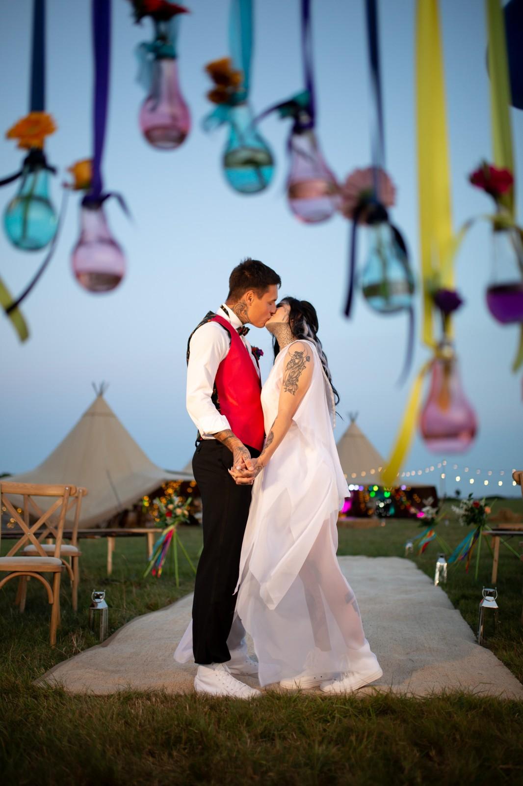 rainbow festival wedding - colourful wedding - quirky wedding ideas - festival wedding ceremony - coloured lightbulbs decoration