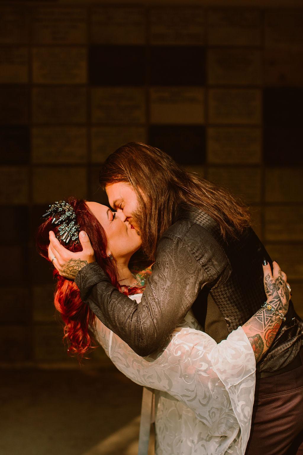 alternative micro wedding - bride and groom kiss - edgy wedding