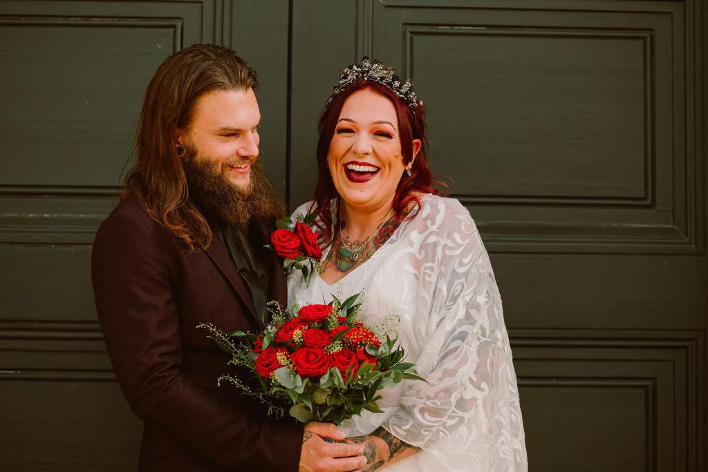 alternative micro elopement - joyful wedding photo - alternative wedding - bohemian wedding dress and red roses bouquet