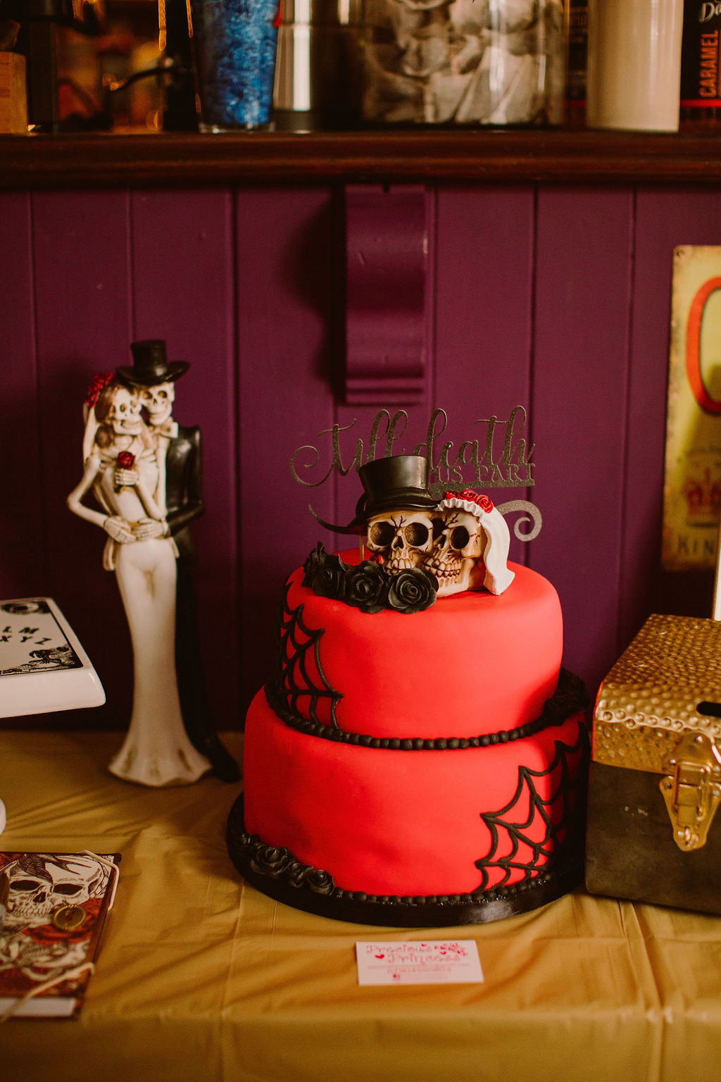 red and black gothic wedding cake - red wedding cake with skulls and cobwebs - alternative wedding cake