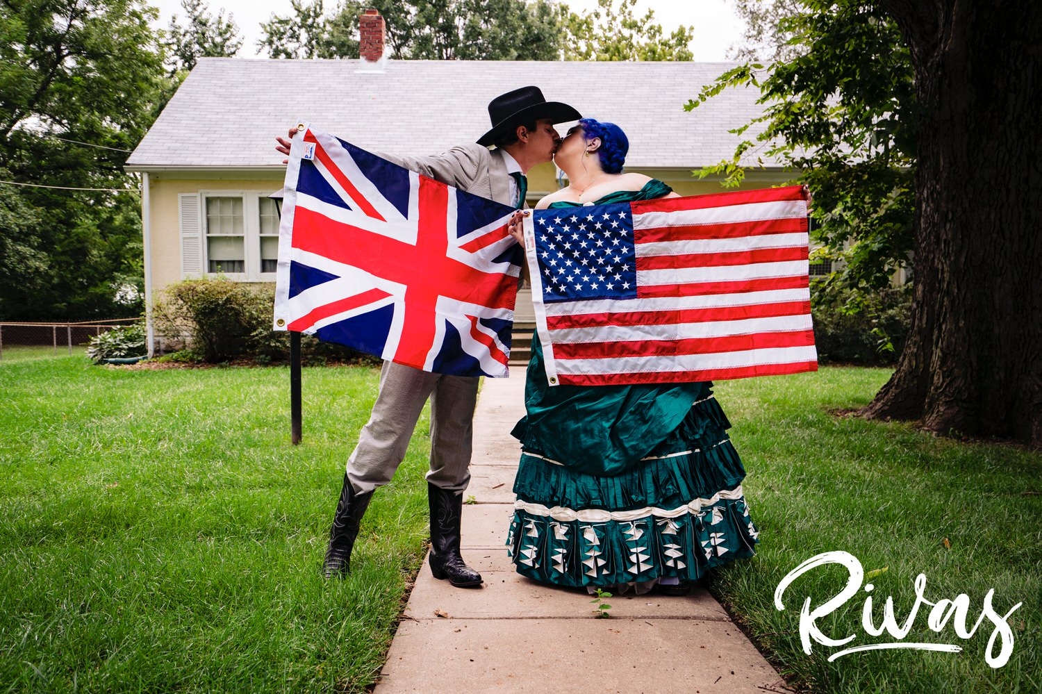 bride and groom holding english and american flags