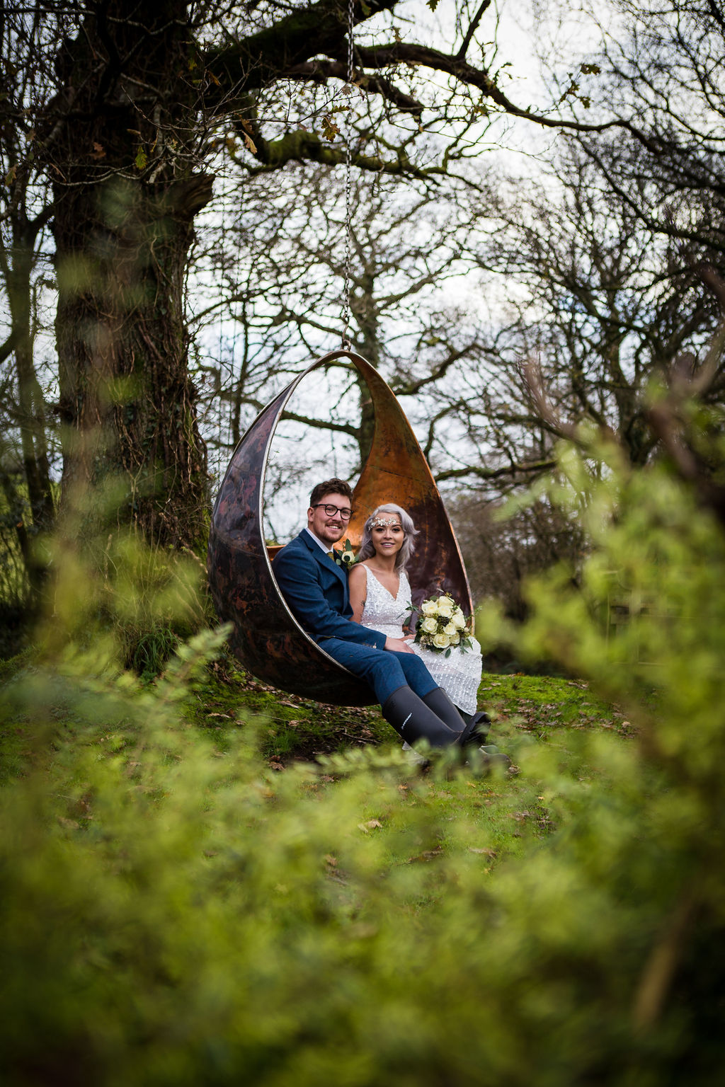 bride and groom in swing - winter elopement - simple wedding - pandemic wedding - small wedding - unconventional wedding