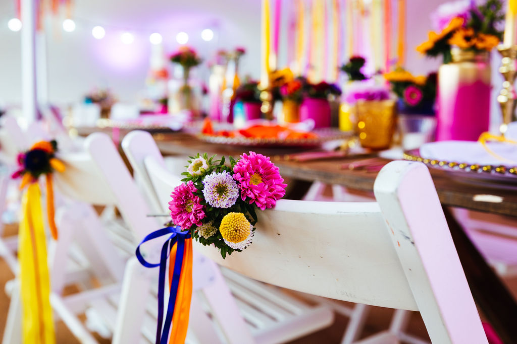 bright festival wedding - colourful boho wedding flowers - boho wedding chair decoration - marquee wedding styling