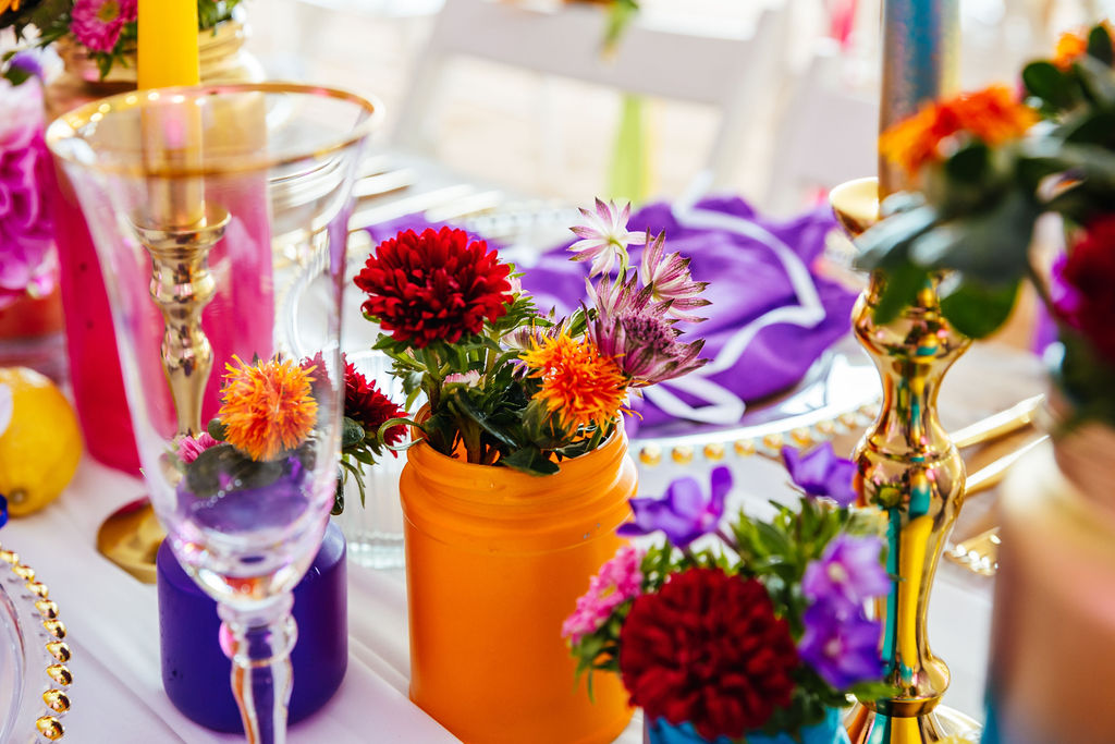 bright festival wedding - colourful wedding flowers in eclectic vases