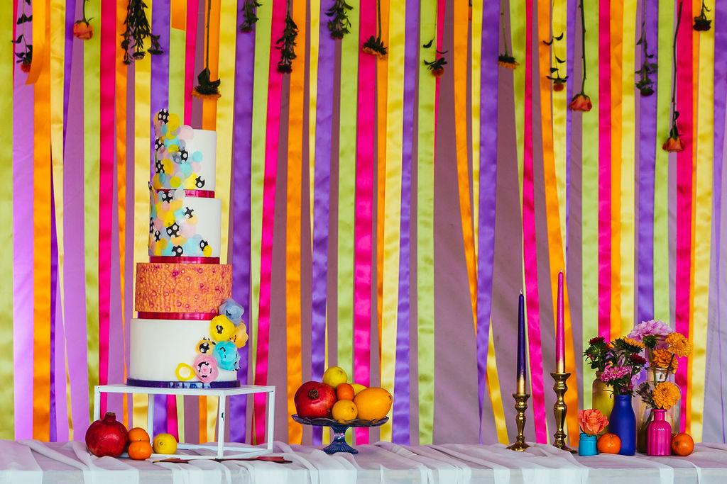 colourful wedding cake - wedding ribbon backdrop - quirky wedding styling - colourful wedding styling