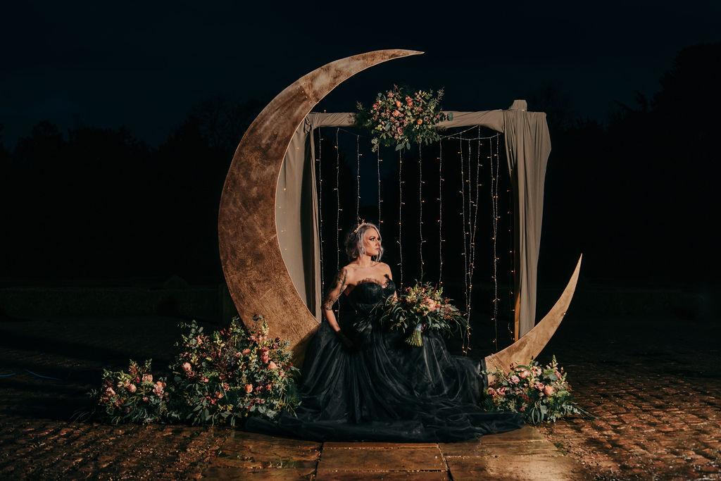 gothic celestial wedding - black wedding dress - wedding moon prop - unique wedding prop hire - unique wedding styling