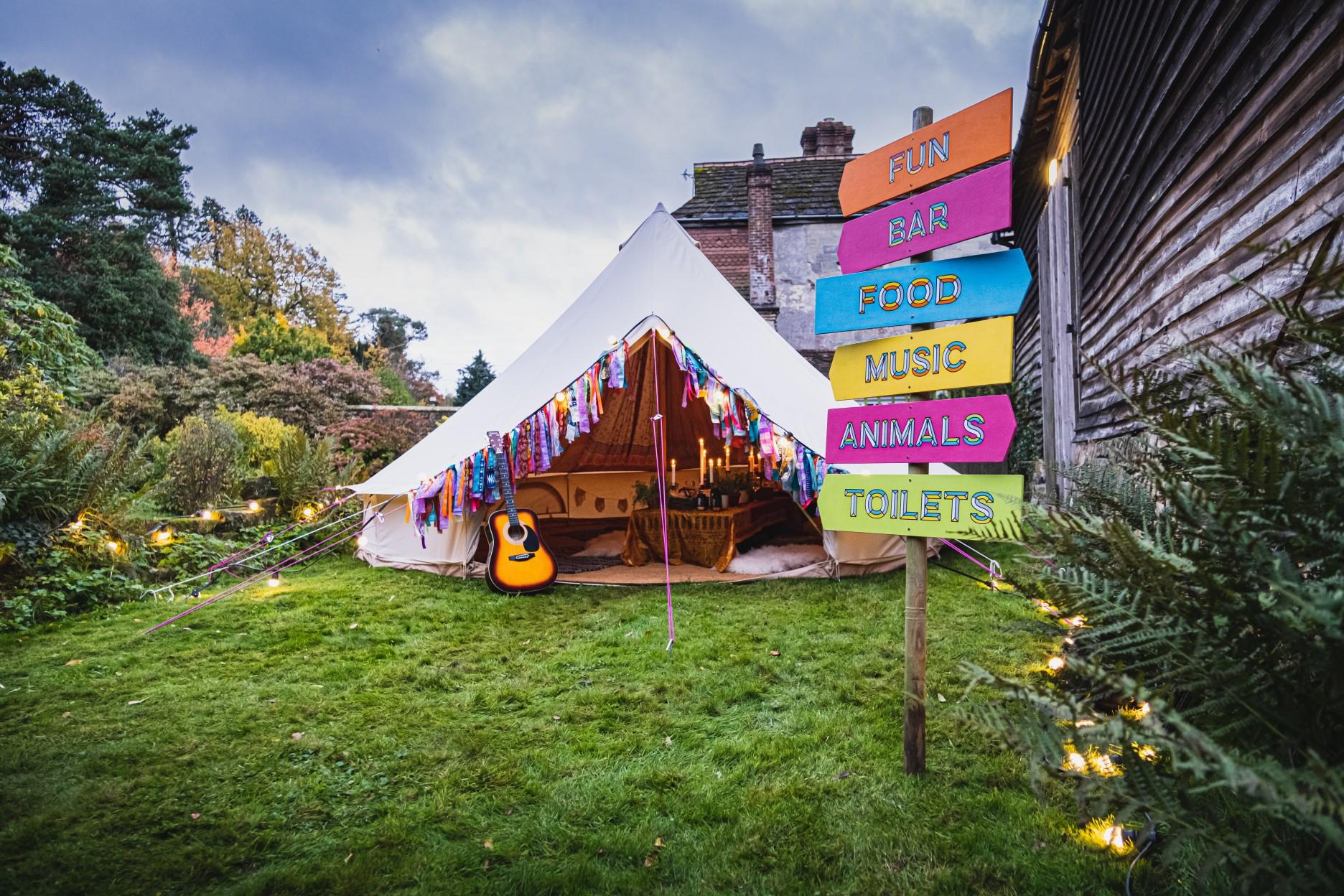 colourful micro wedding at patricks barn - festival wedding - raainbow wedding - bell tent wedding - unique wedding signage