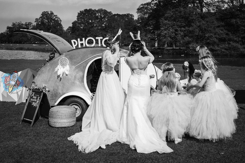 Kirsty rockett photography with pixie the photobooth - wedding photobooth teardrop caravan with bridal party