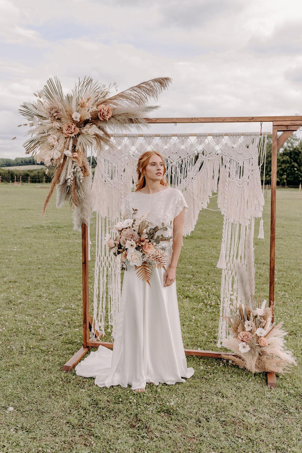 sustainable boho wedding - macrame wedding backdrop - boho wedding flowers - bohemian bridal wear - sustainable wedding