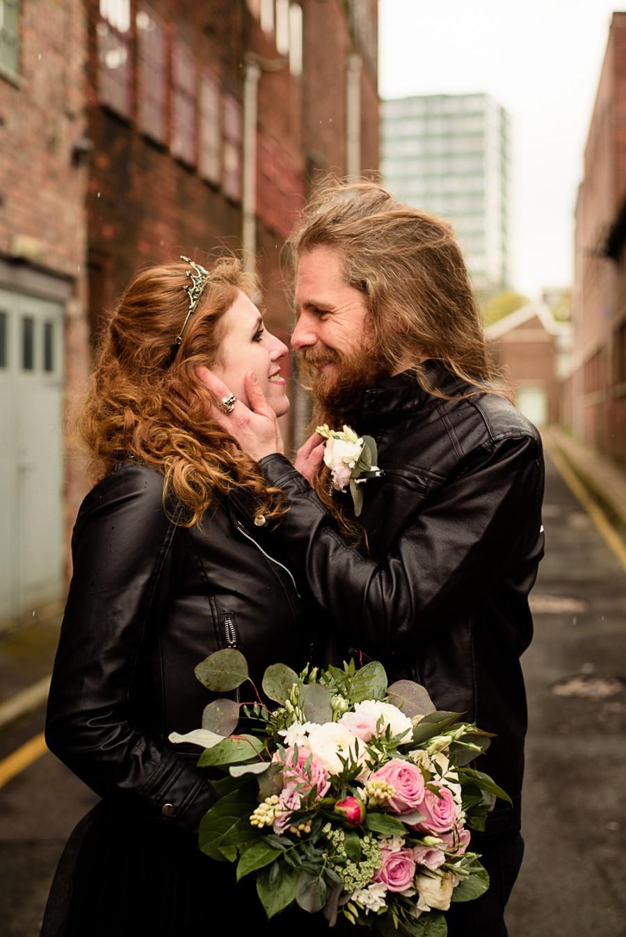 gothic city wedding - alternative wedding - gothic micro wedding - black wedding dress - bride and groom in leather jacket - rock wedding