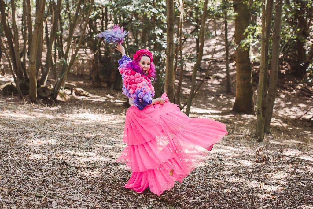 fun festival wedding - bridal pom pom jacket - pink bride - festival bride - coloured wedding dress - colourful wedding dress - bridal pom pom headdress - unconventional wedding - pink wedding dress - unique bridalwear